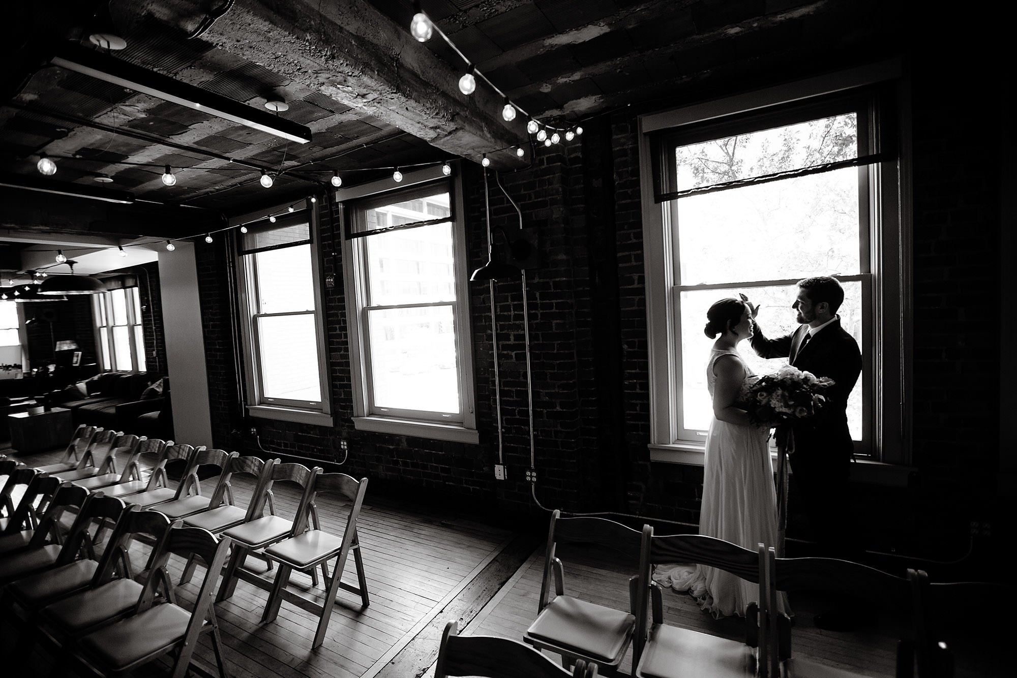 Loft at 600 F Wedding  I  The bride and groom share their first look.