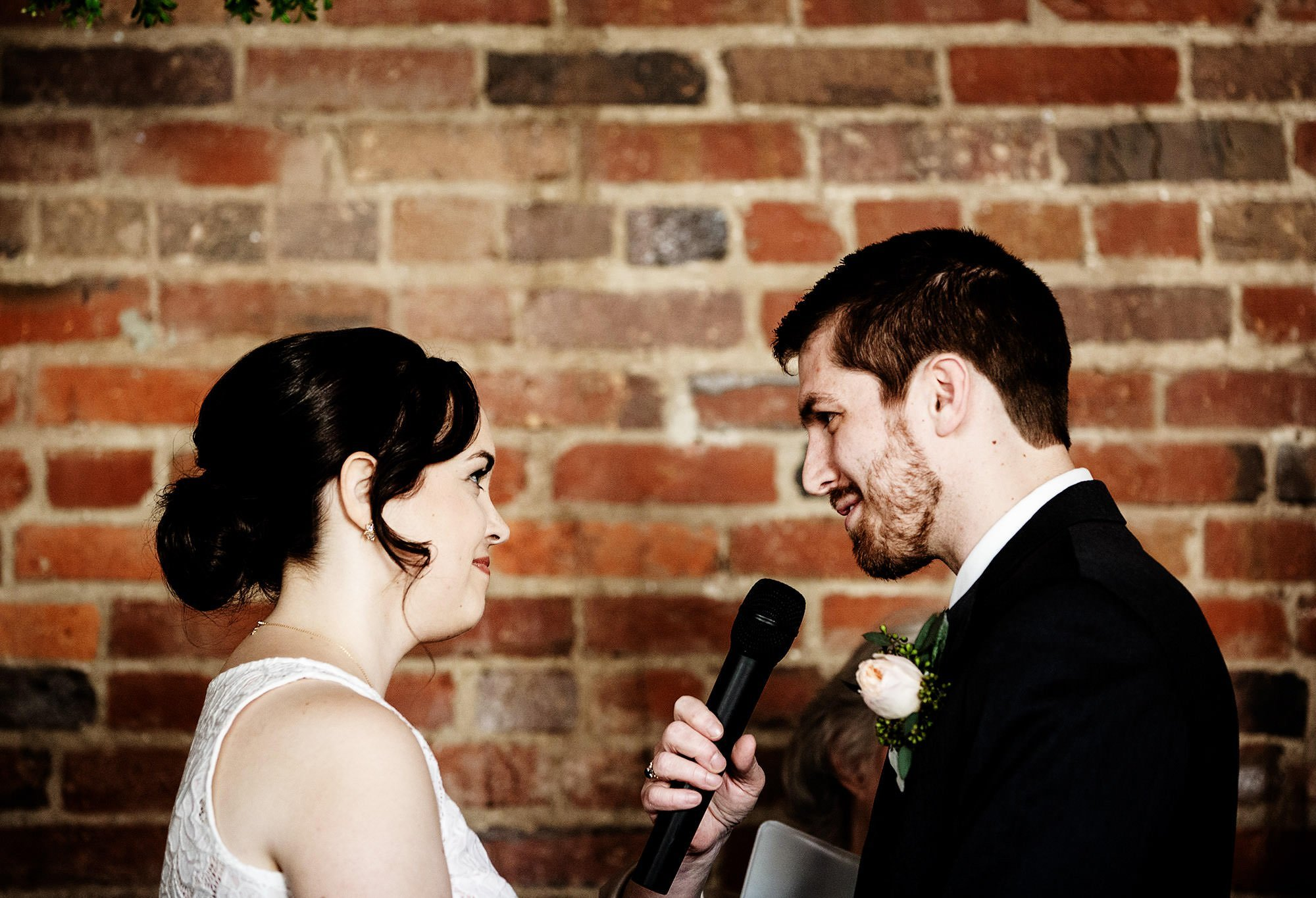 Loft at 600 F Wedding  I  The groom shares his vows.