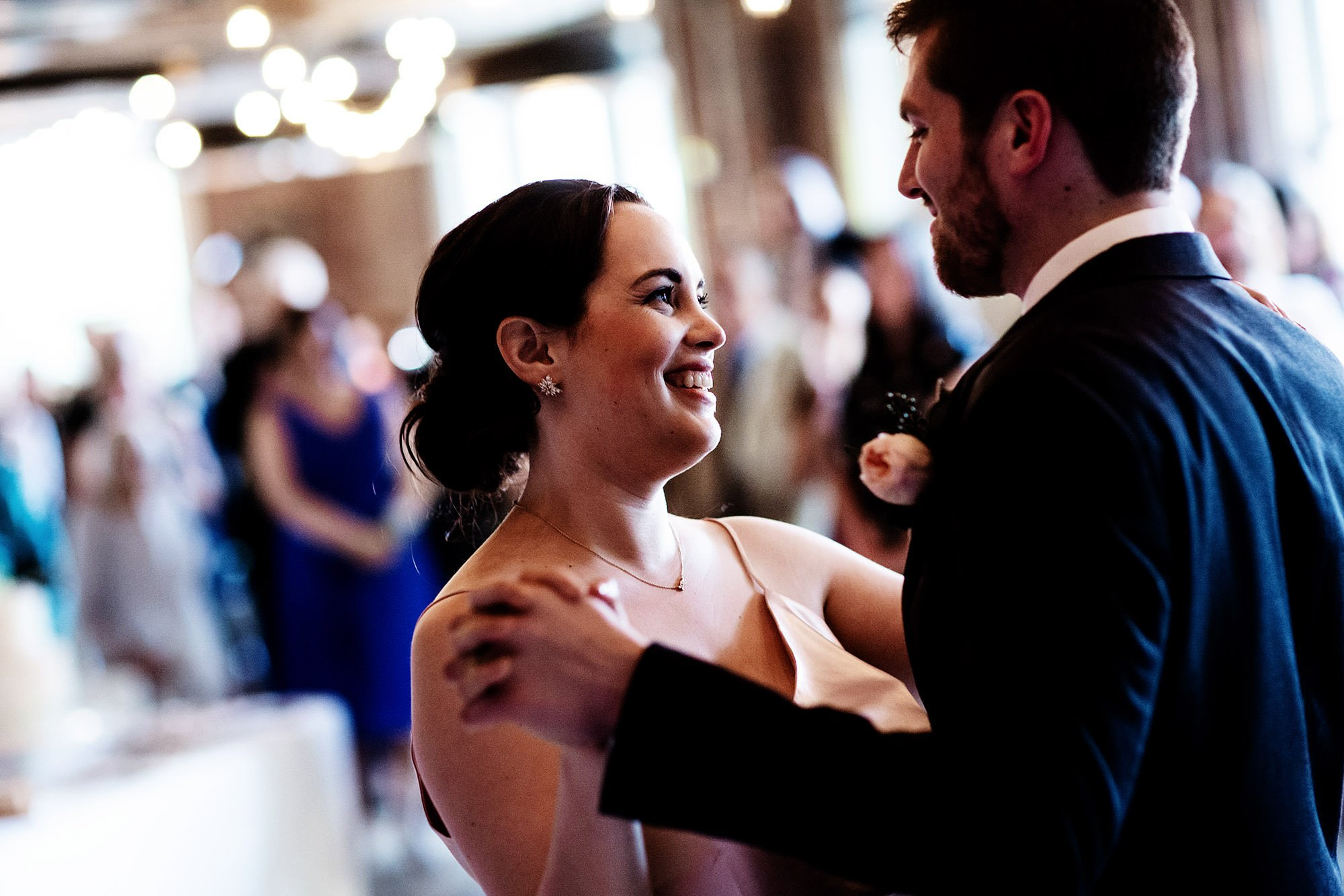 Loft at 600 F Wedding  I  The couple share their first dance during the wedding reception.