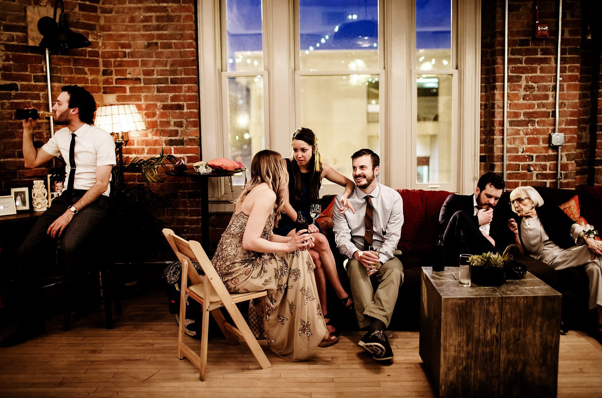 Loft at 600 F Wedding  I  Guests chat during cocktail hour.