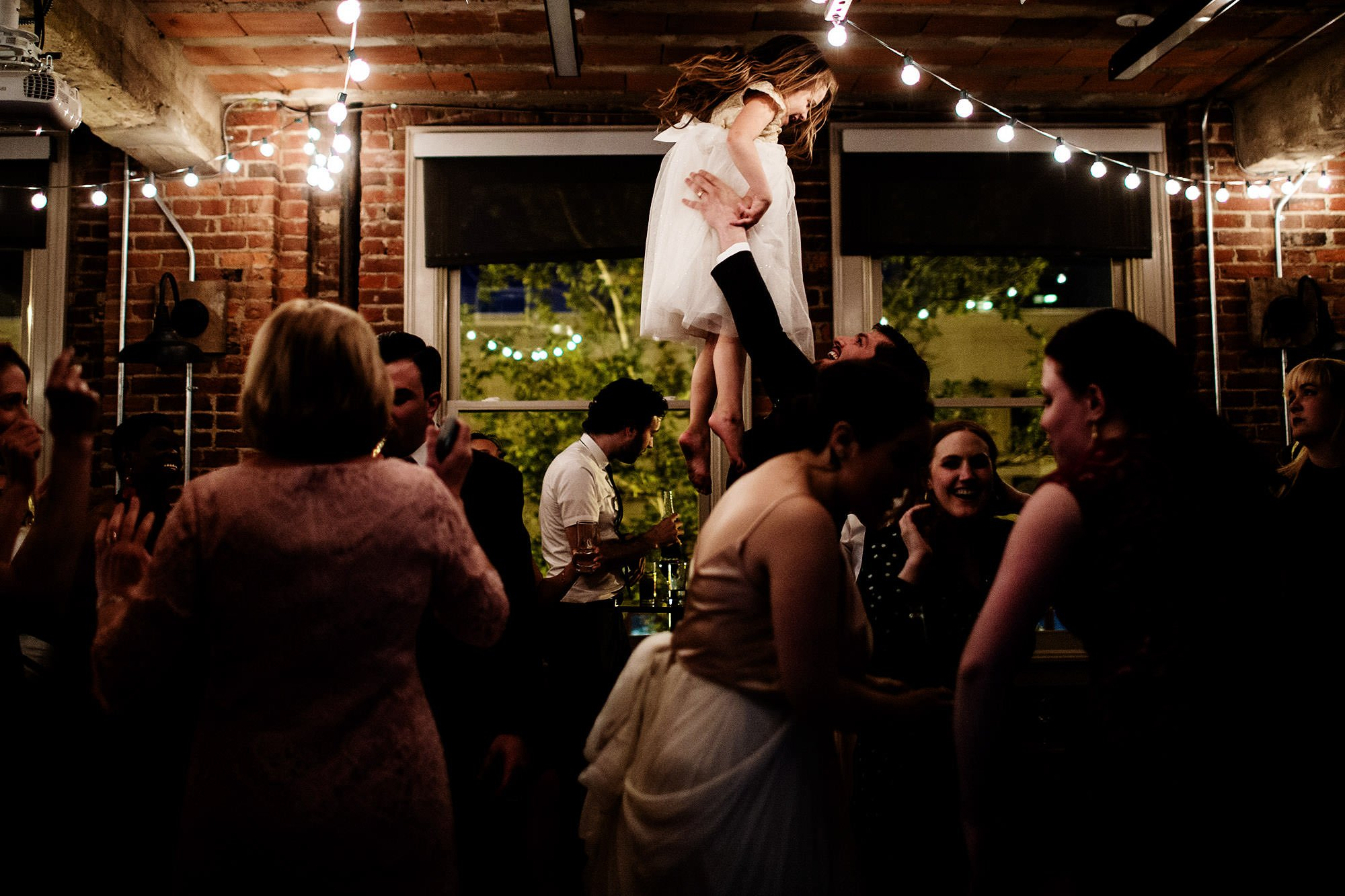 Loft at 600 F Wedding  I  Guests dance during the wedding reception in Washington, DC.