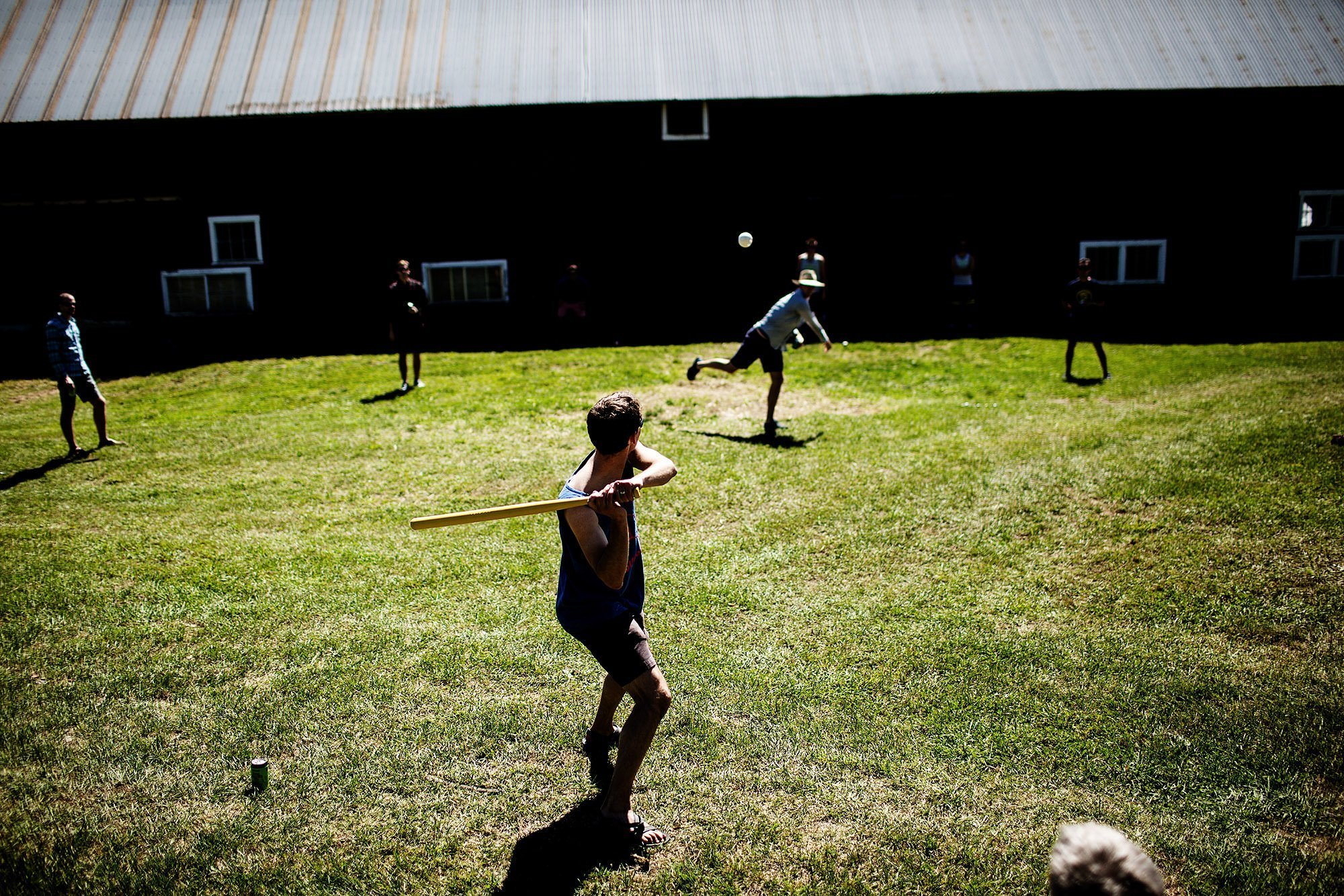 Vermont Family Farm Wedding  I  The groomsmen play wiffleball before the wedding ceremony.