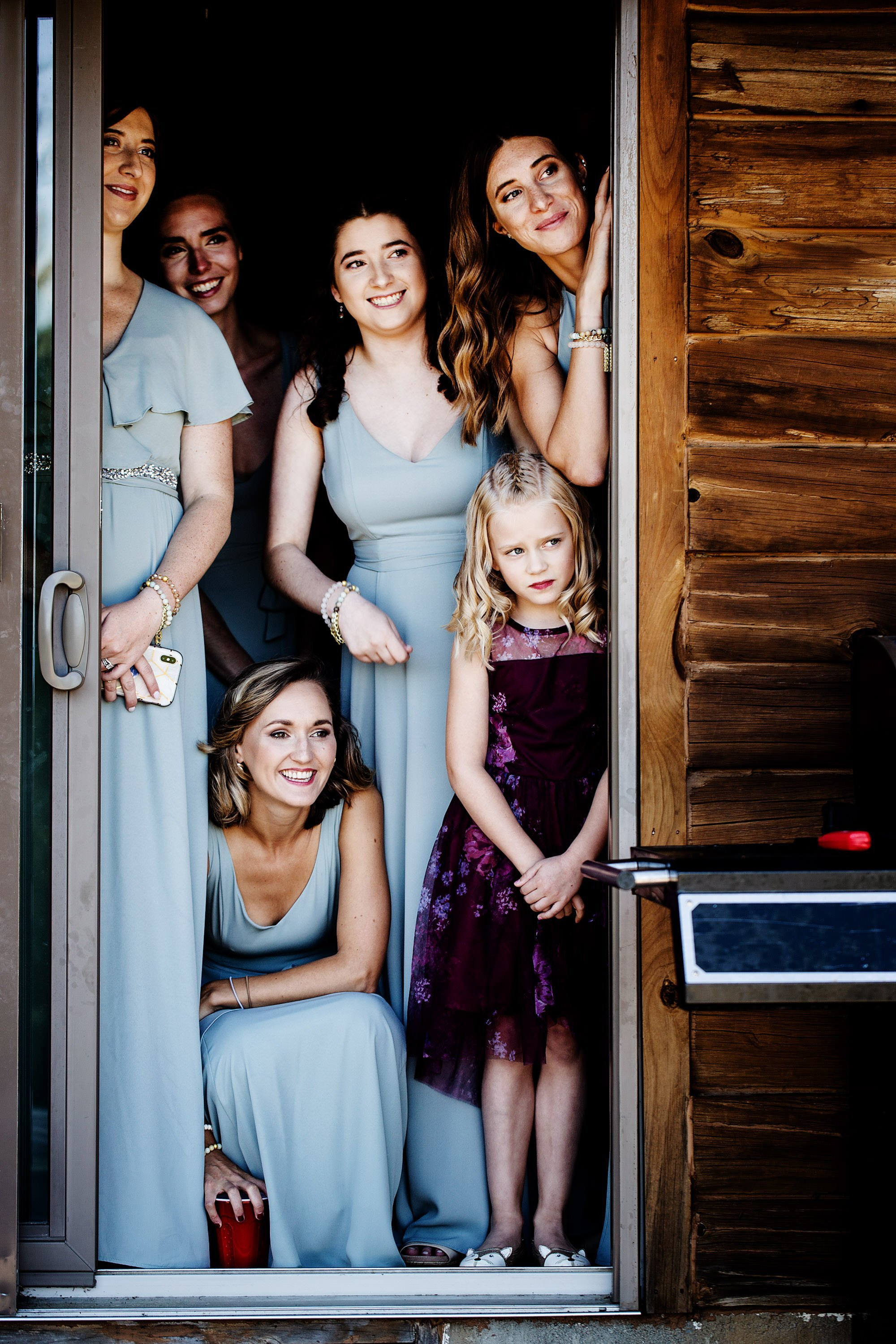 Vermont Family Farm Wedding  I  Bridesmaids watch as the couple share their first look.  I  Vermont Wedding Photographers  I  The Happy Couple Photography, LLC