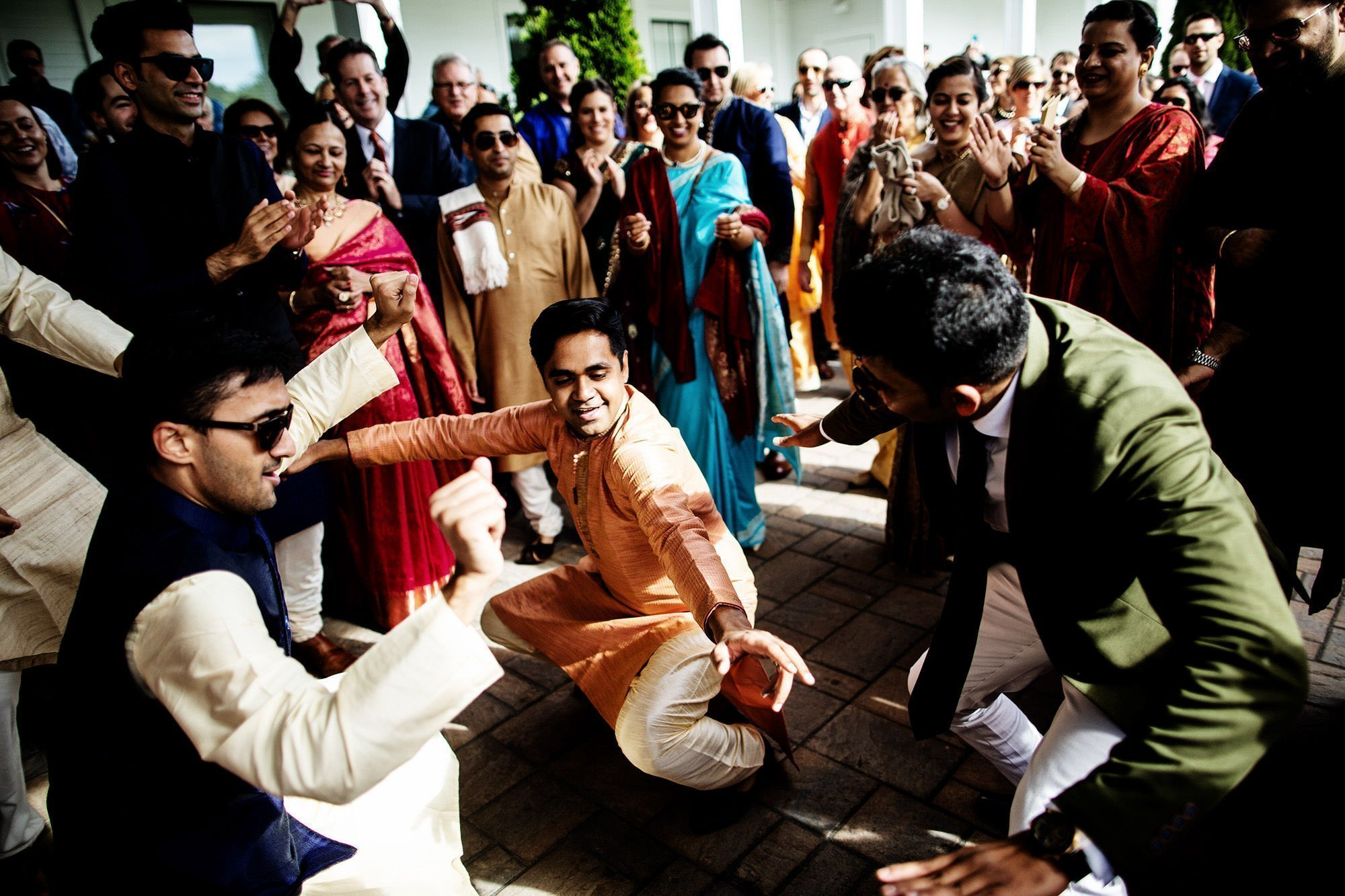 Wentworth by the Sea Wedding  I  Guests dance during the Baraat before the Hindu wedding ceremony.