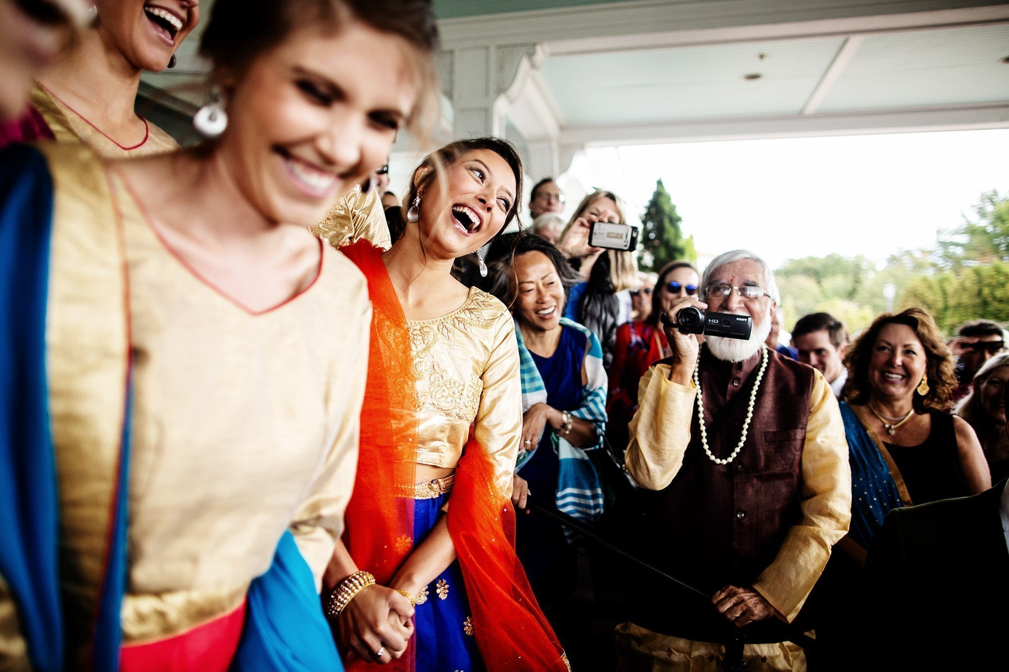 Wentworth by the Sea Wedding  I  The groom is greeted by bridesmaids before the Hindu ceremony.