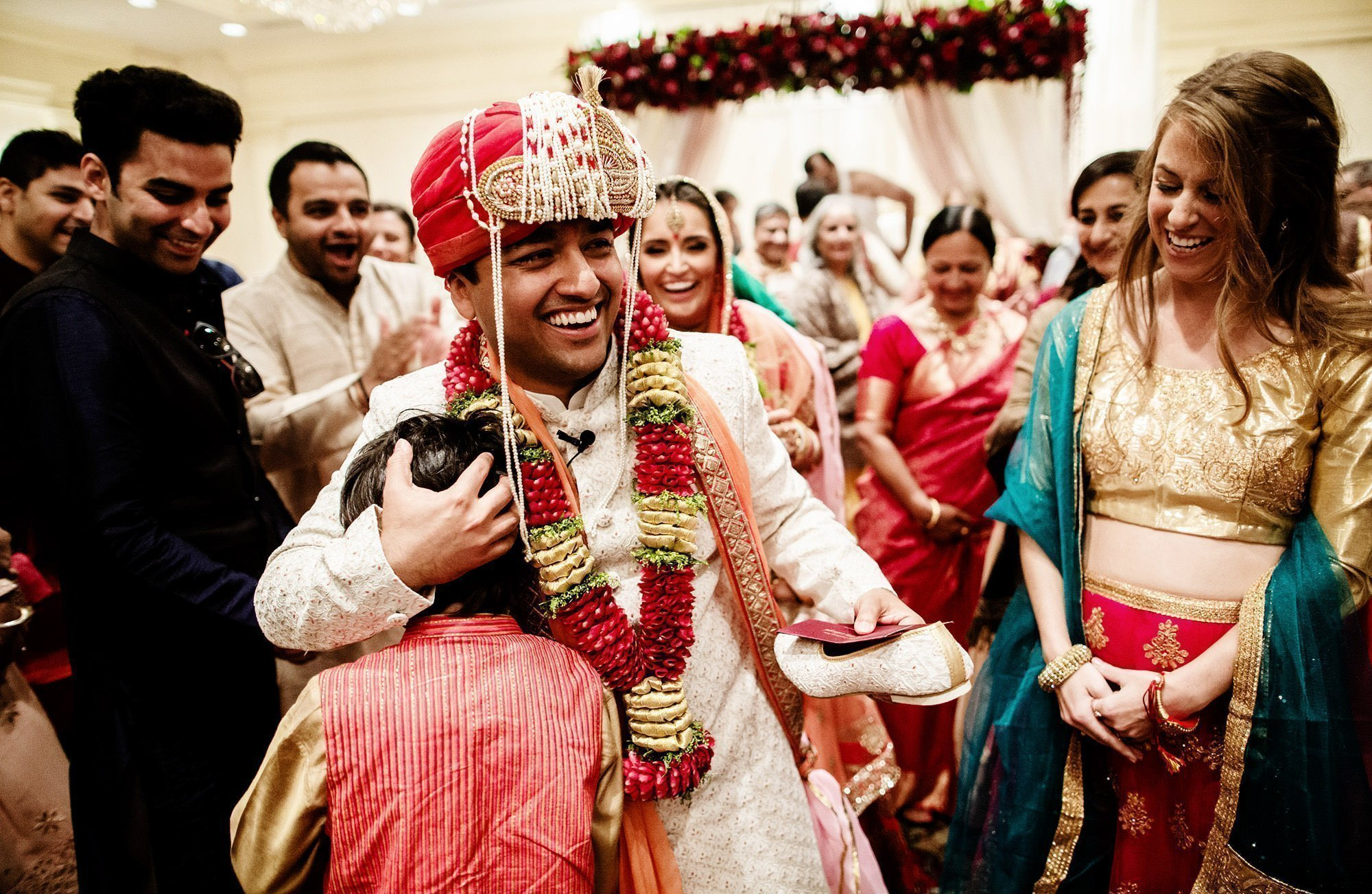 Wentworth by the Sea Wedding  I  The groom smiles at the conclusion of the Hindu ceremony.