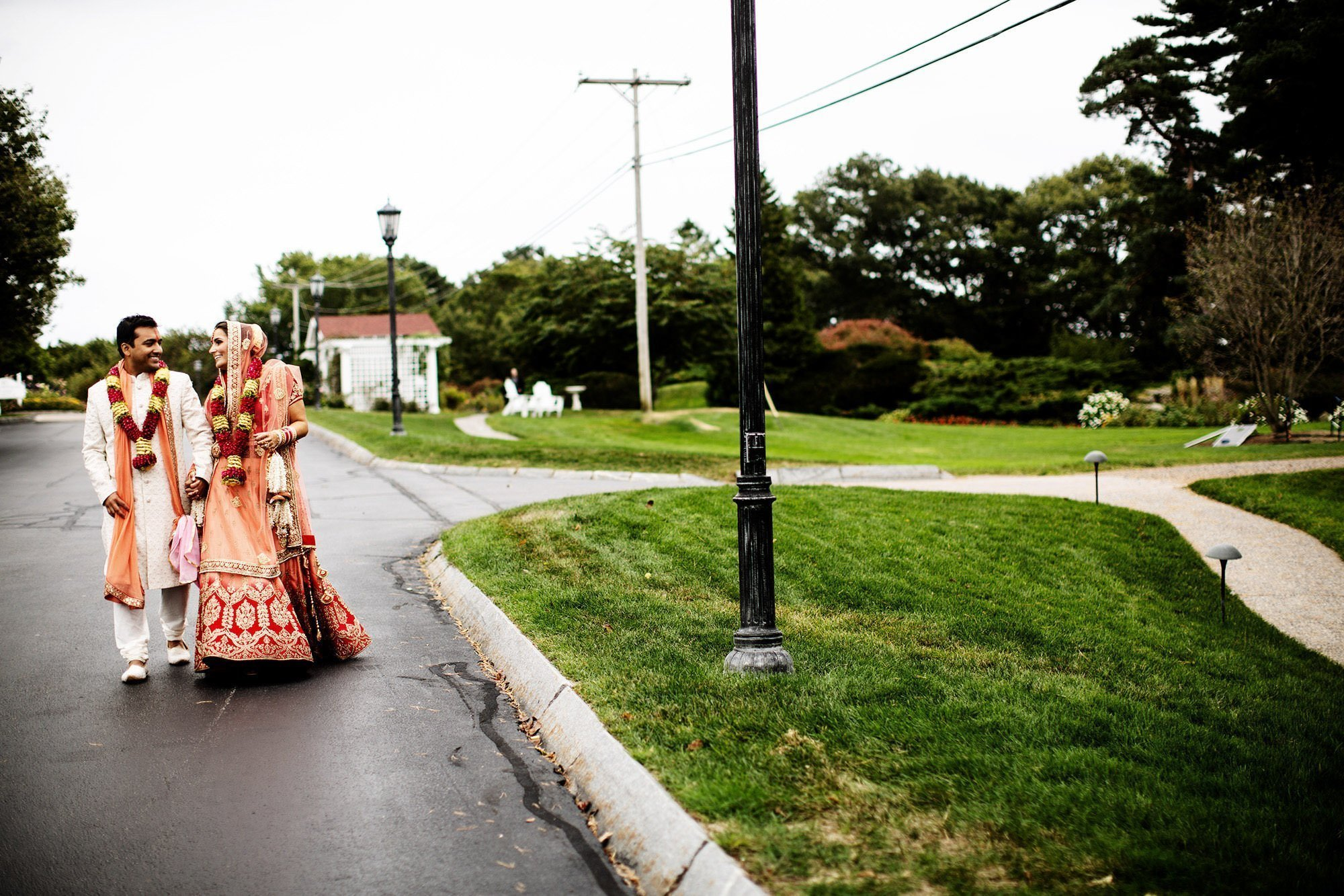 Wentworth by the Sea Wedding  I  The bride and groom walk together following the Hindu ceremony.