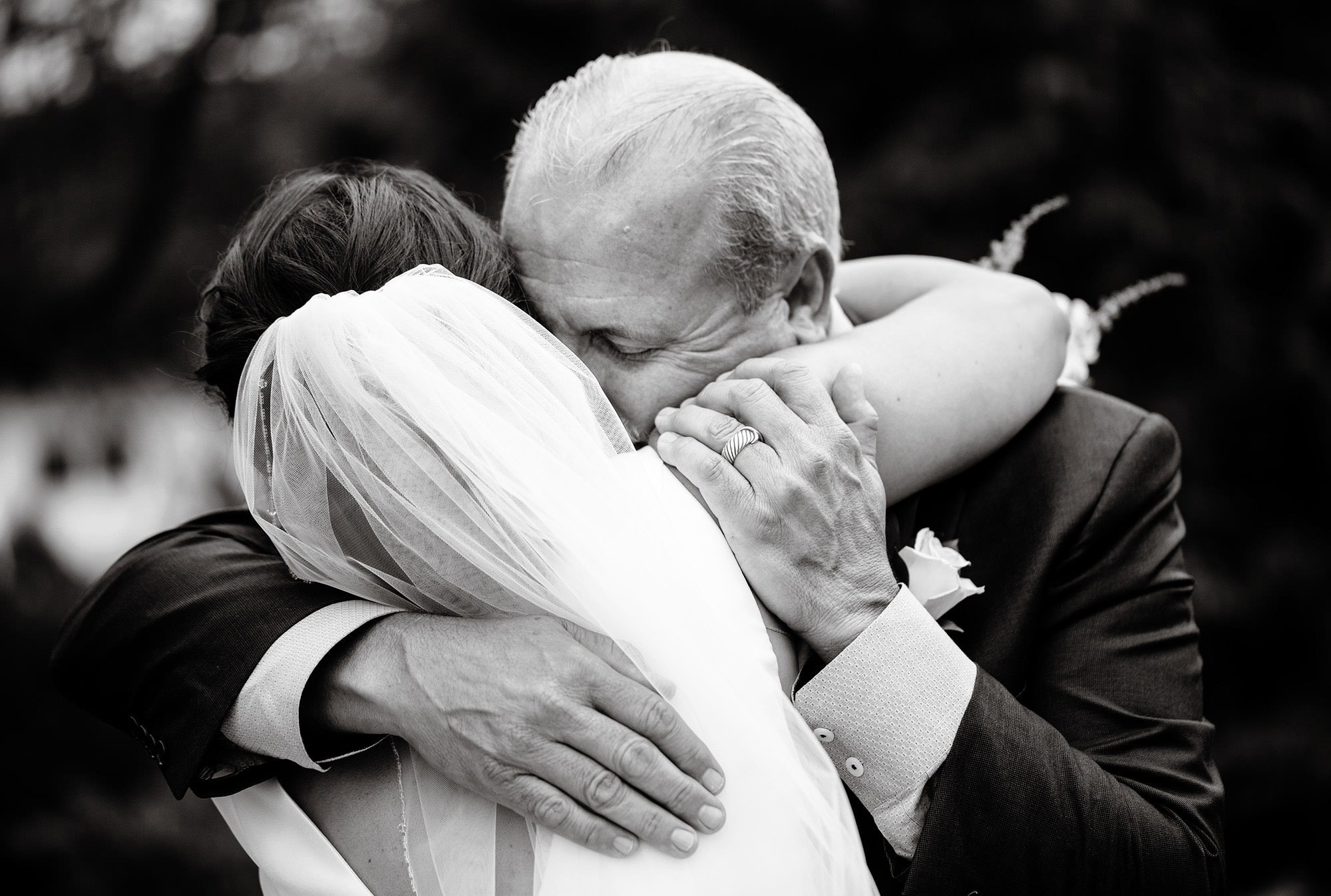 Wentworth by the Sea Wedding  I  The father of the bride hugs his daughter before the wedding ceremony.