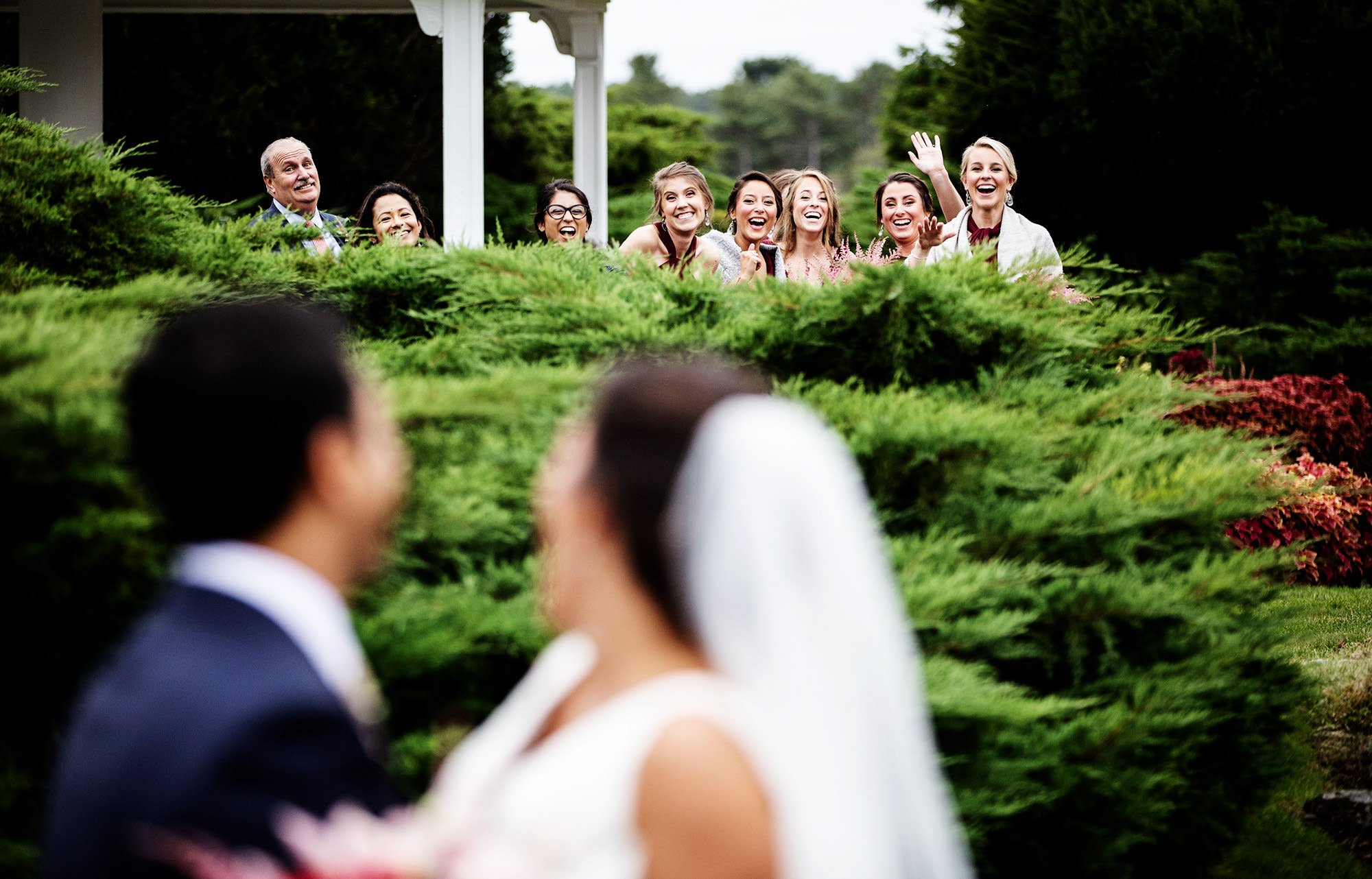Wentworth by the Sea Wedding  I  The bridal party waves at the bride and groom during their First Look.