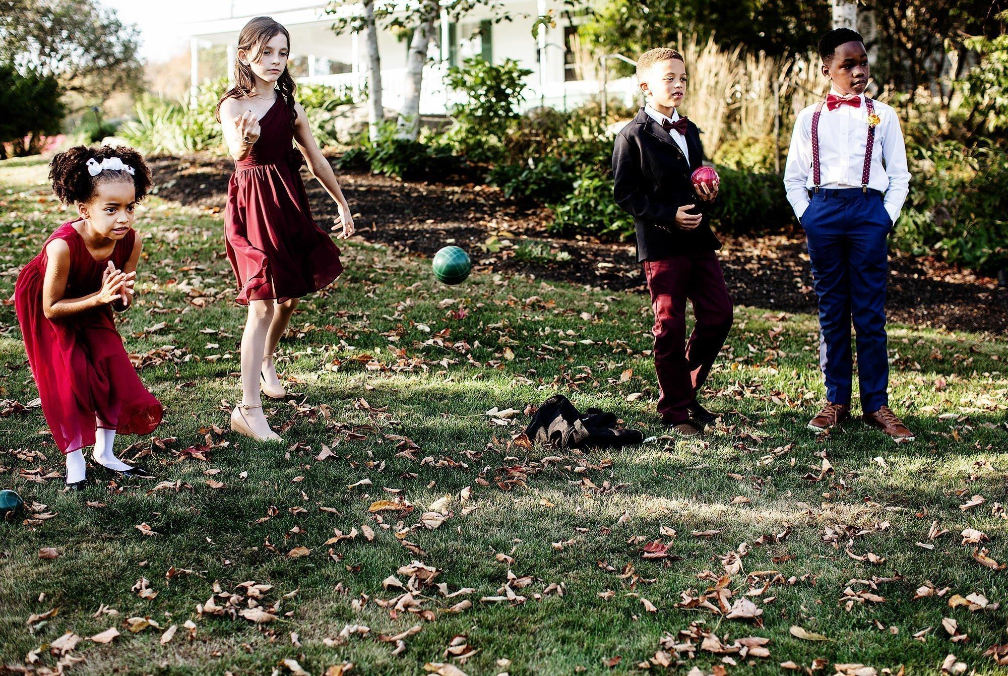 Harrington Farm Wedding  I  Kids play bocce ball before the ceremony.