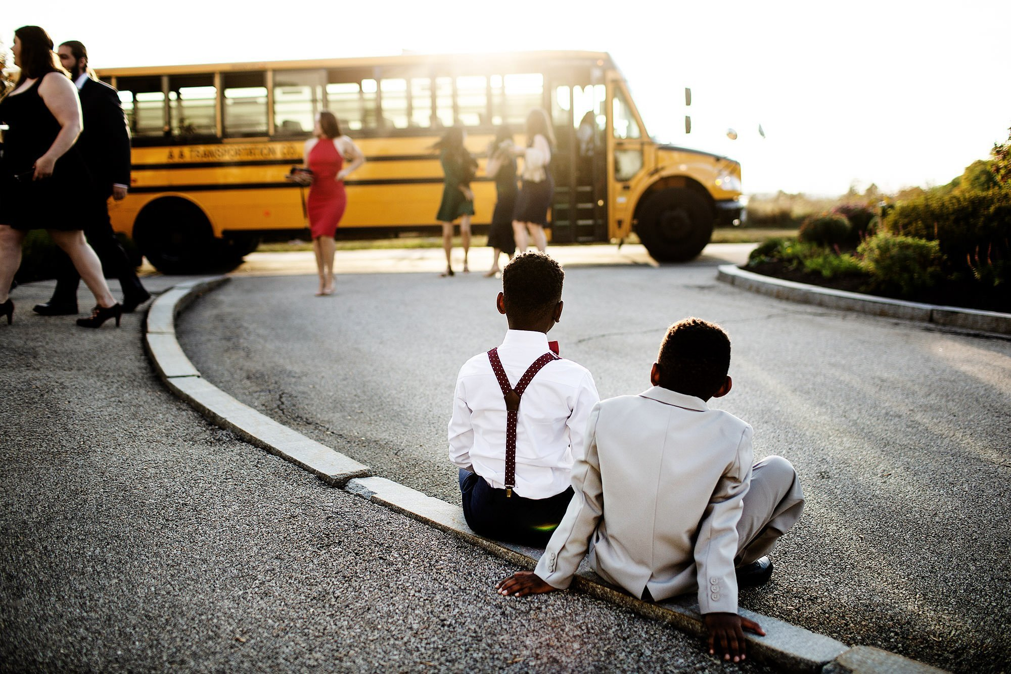 Harrington Farm Wedding  I  Kids watch as a bus brings guests to the ceremony site in Princeton, MA.