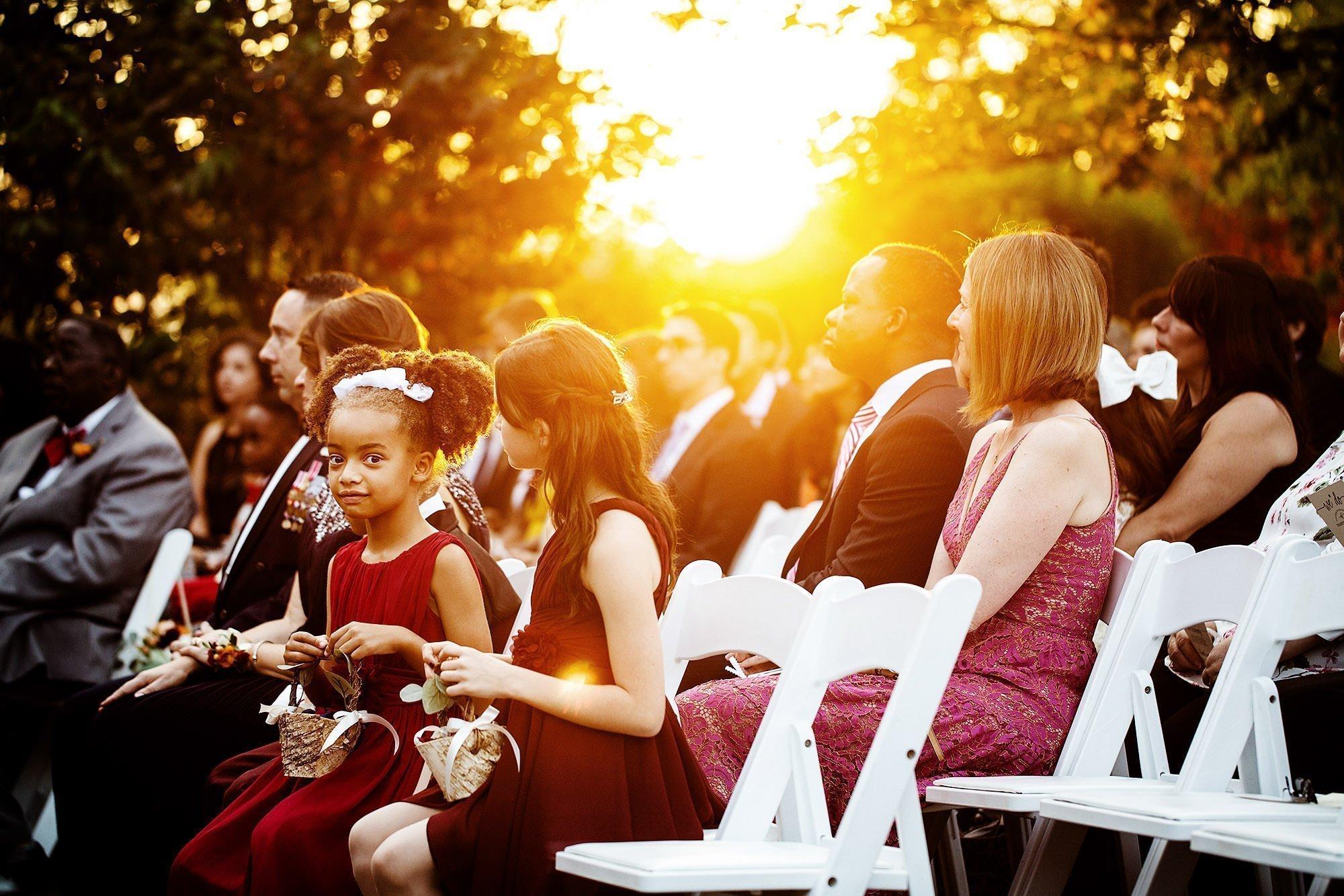 Harrington Farm Wedding  I  Flower girls watch the ceremony during sunset in Princeton, MA.