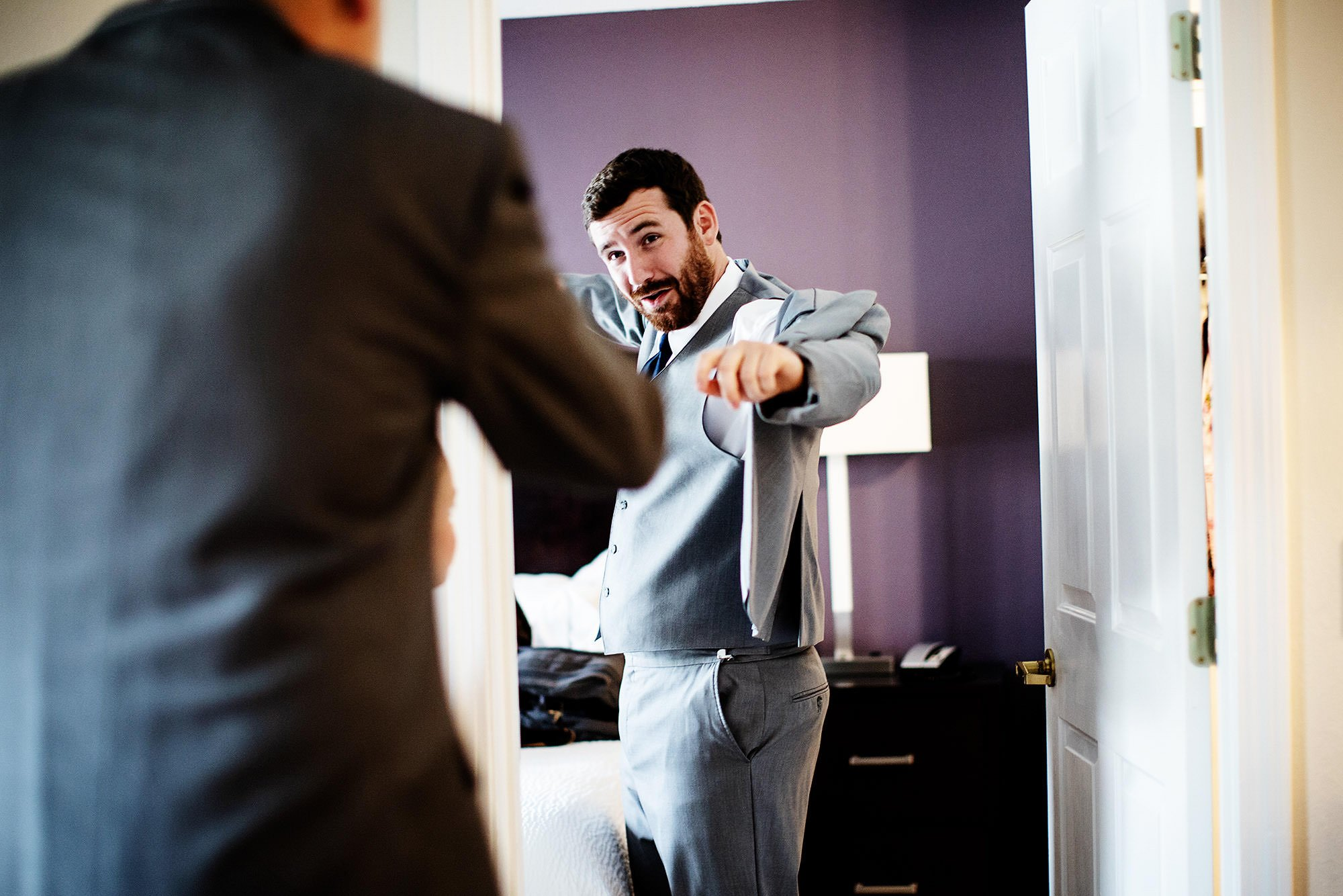 Lake Pearl Wrentham Wedding  I  A groomsman gets ready before the wedding ceremony.