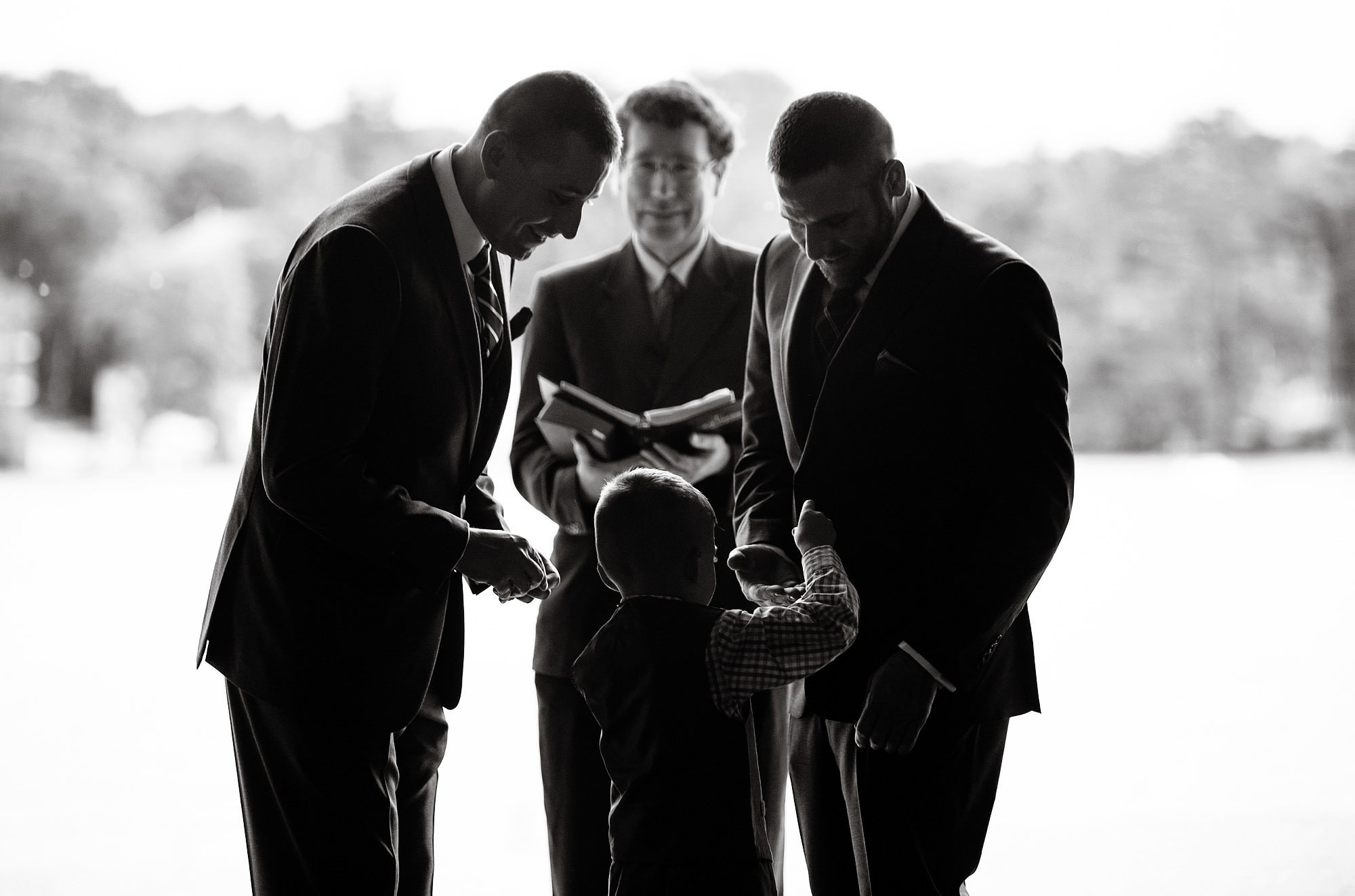 Lake Pearl Wrentham Wedding  I  The grooms take their wedding rings from the ring bearer during the ceremony.
