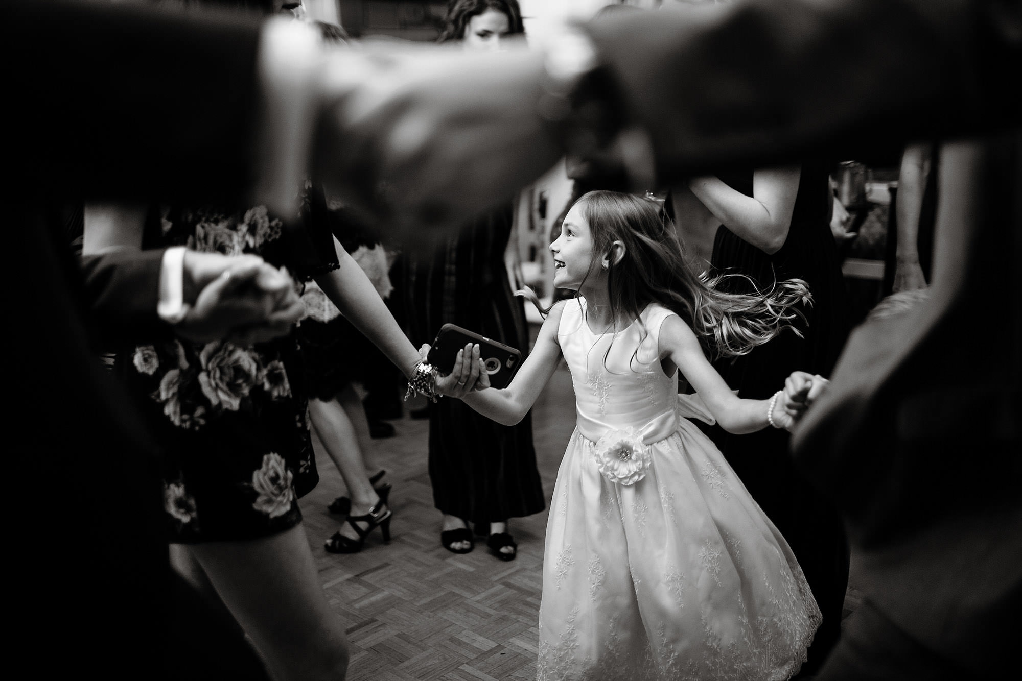Lake Pearl Wrentham Wedding  I  A flower girl dances during the wedding reception.