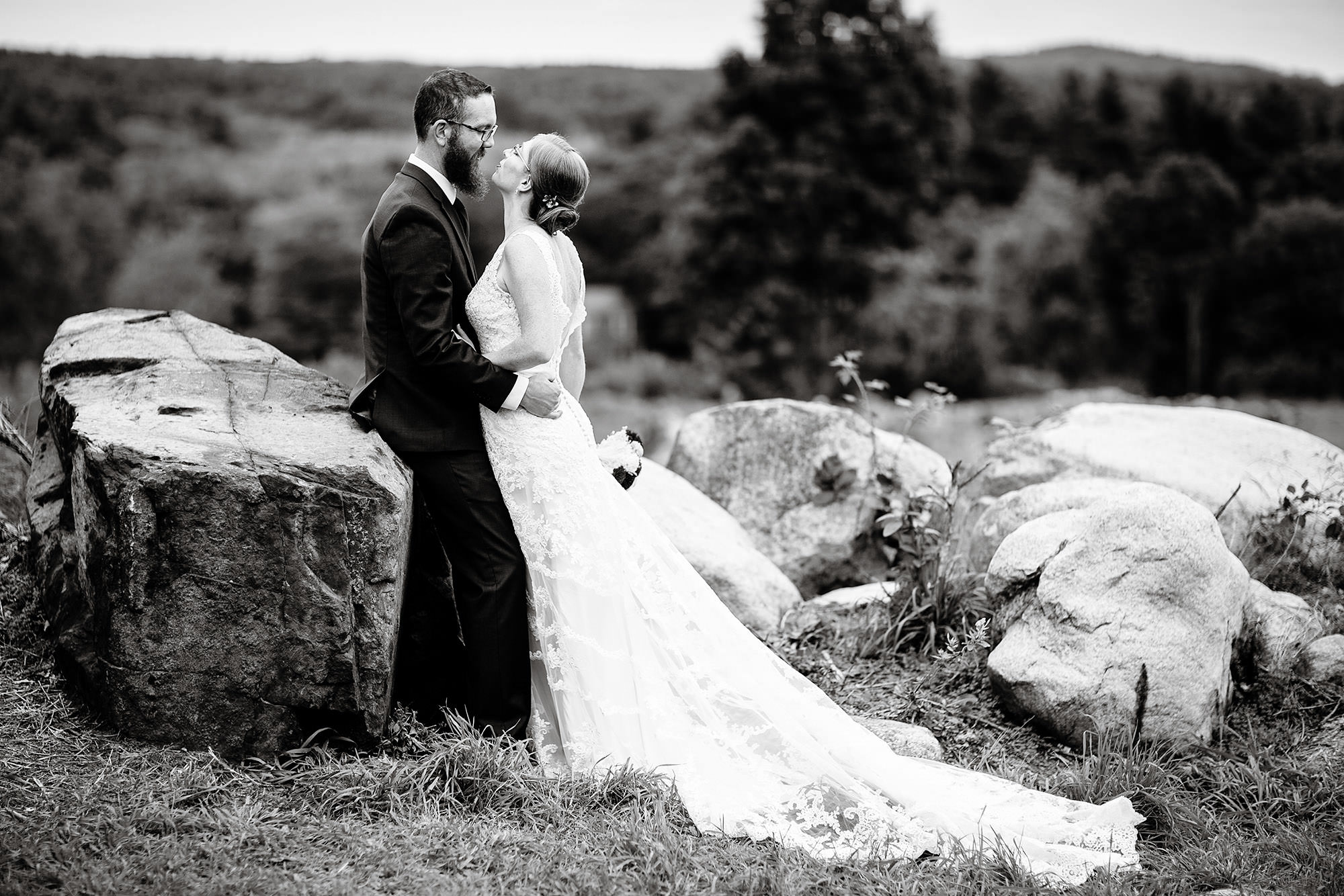 Massachusetts Backyard Wedding  I  The bride and groom kiss at Drew Farms in Westford, MA.