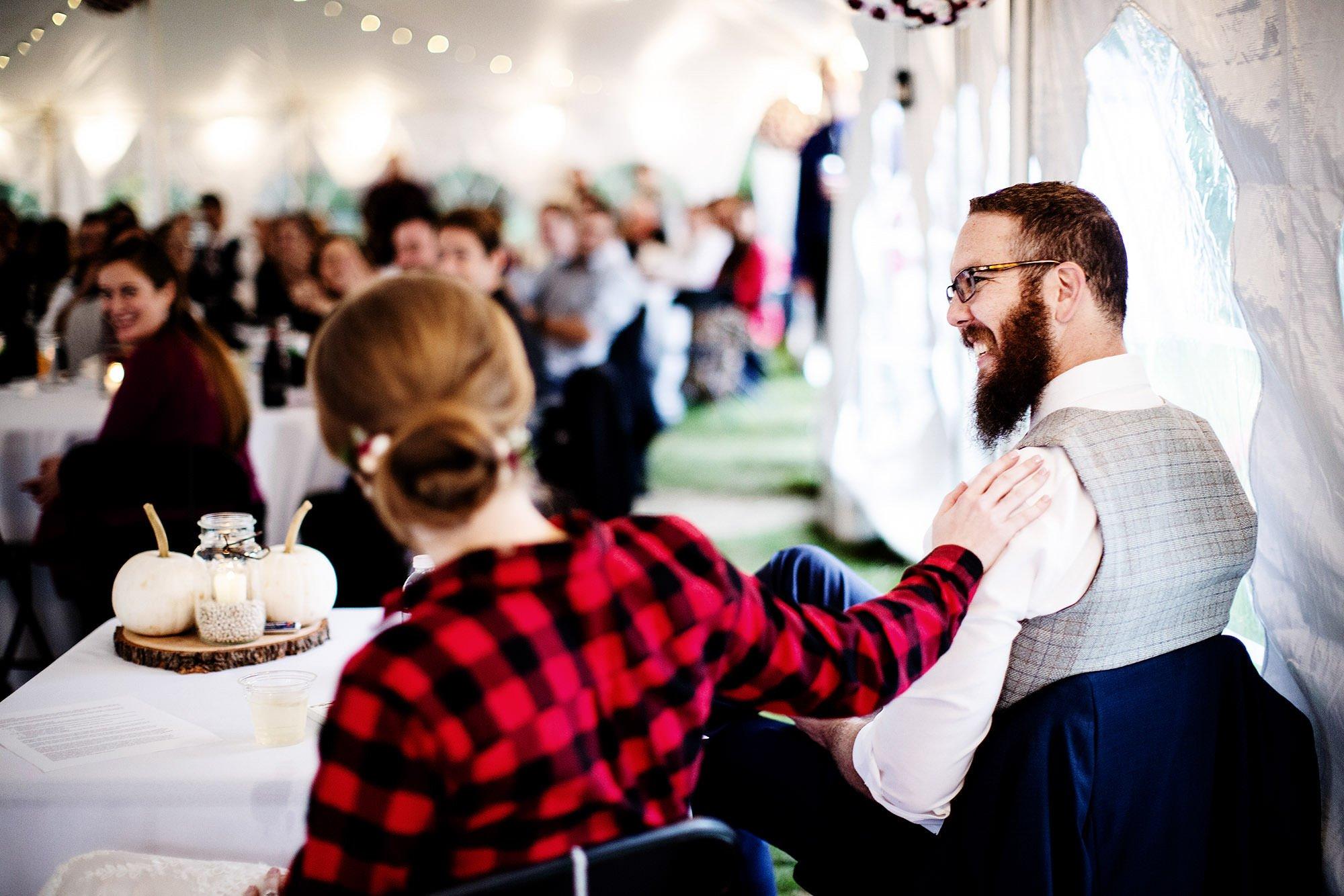 Massachusetts Backyard Wedding  I  The groom smiles during toasts in Westford, MA.