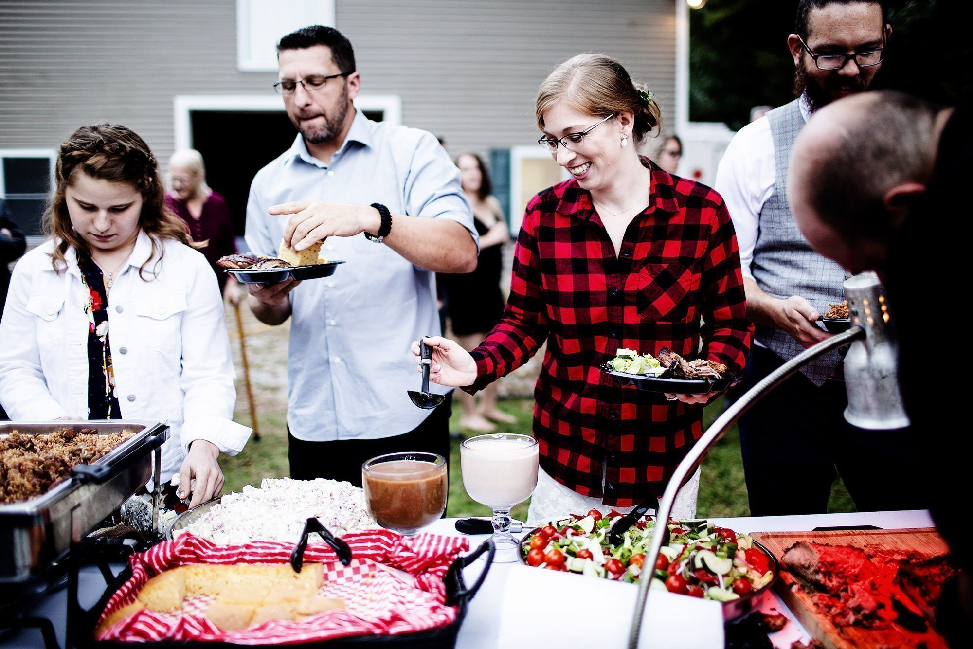 Massachusetts Backyard Wedding  I  Guests eat BBQ during the wedding reception.