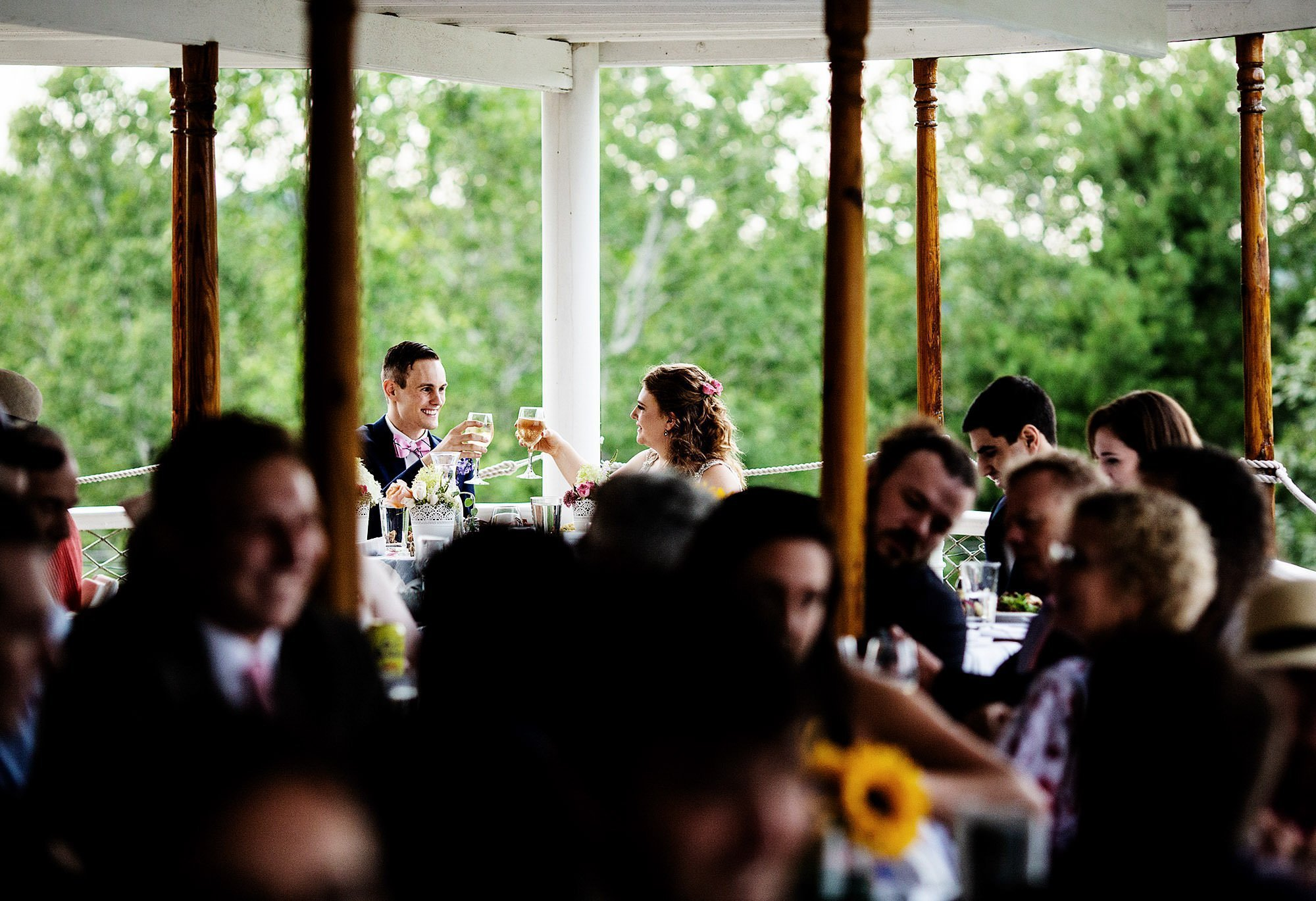 Shelburne Museum Wedding  I  The bride and groom toast during the wedding reception.
