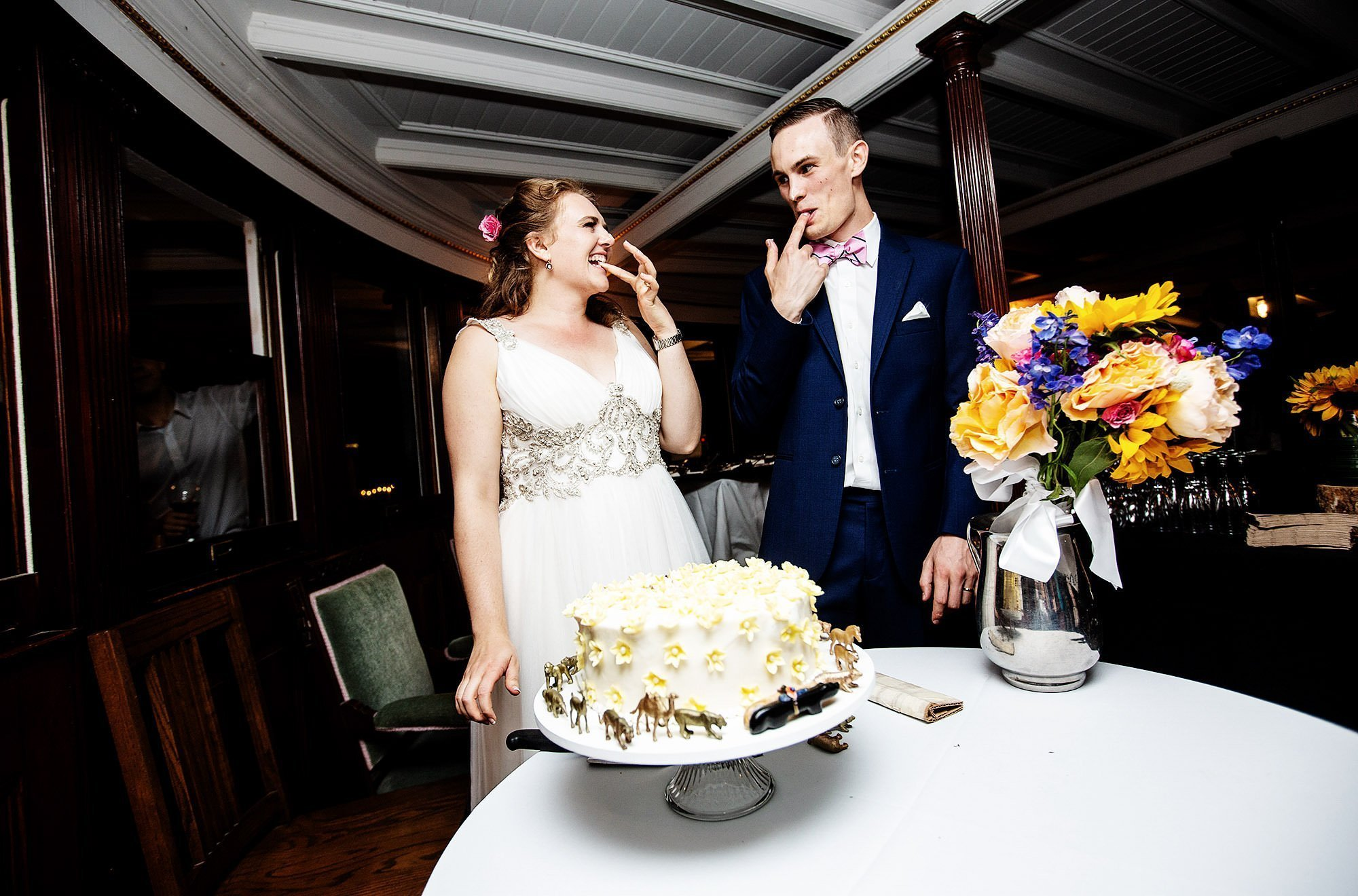 Shelburne Museum Wedding  I  The bride and groom cut their wedding cake during the reception on the Ticonderoga.