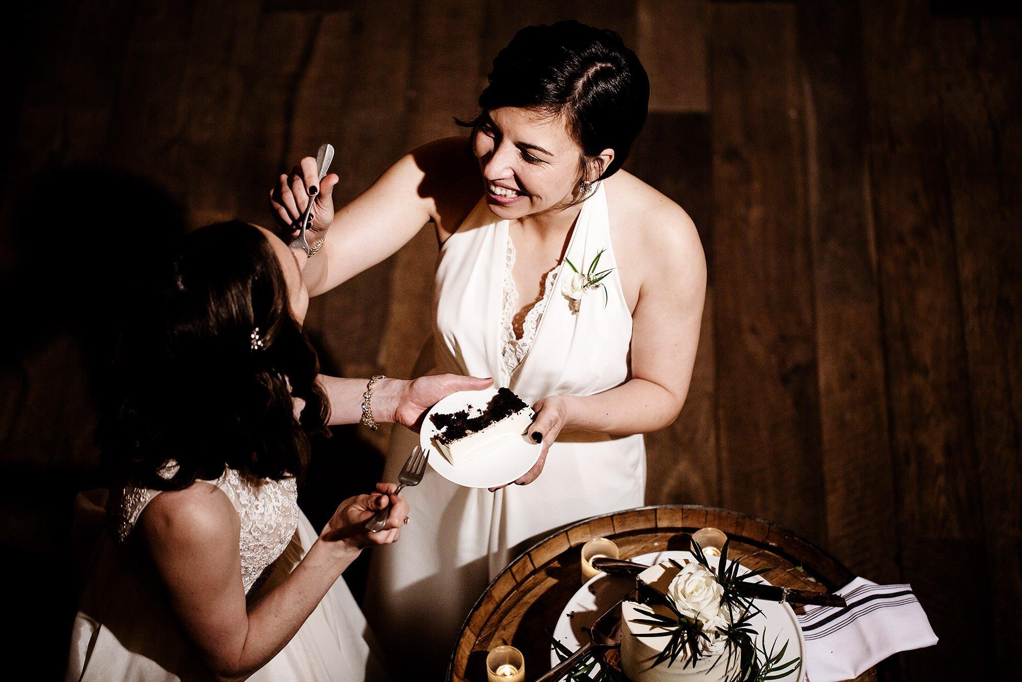 Briar Barn Inn Wedding  I  The brides cut their wedding cake during the wedding reception in Rowley, MA.