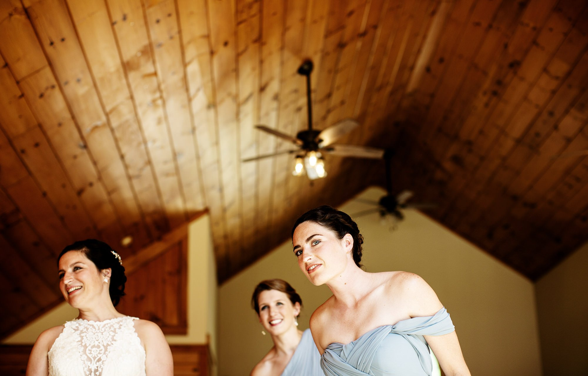 Maine Lakeside Cabin wedding  I  The bridesmaids watch as guests arrive for the wedding ceremony.