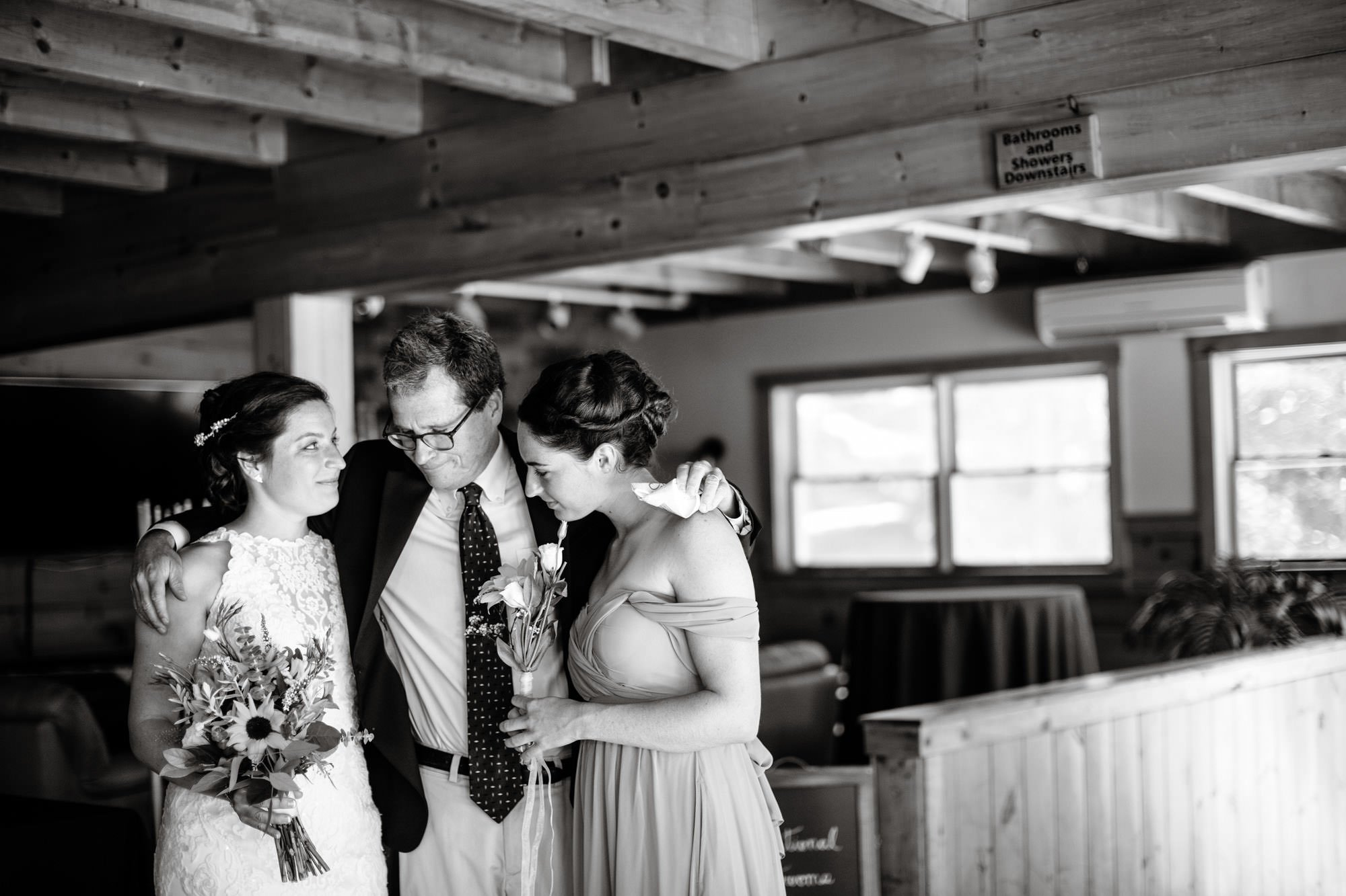 Maine Lakeside Cabin wedding  I  bride waits for the ceremony to begin with her father and sister.
