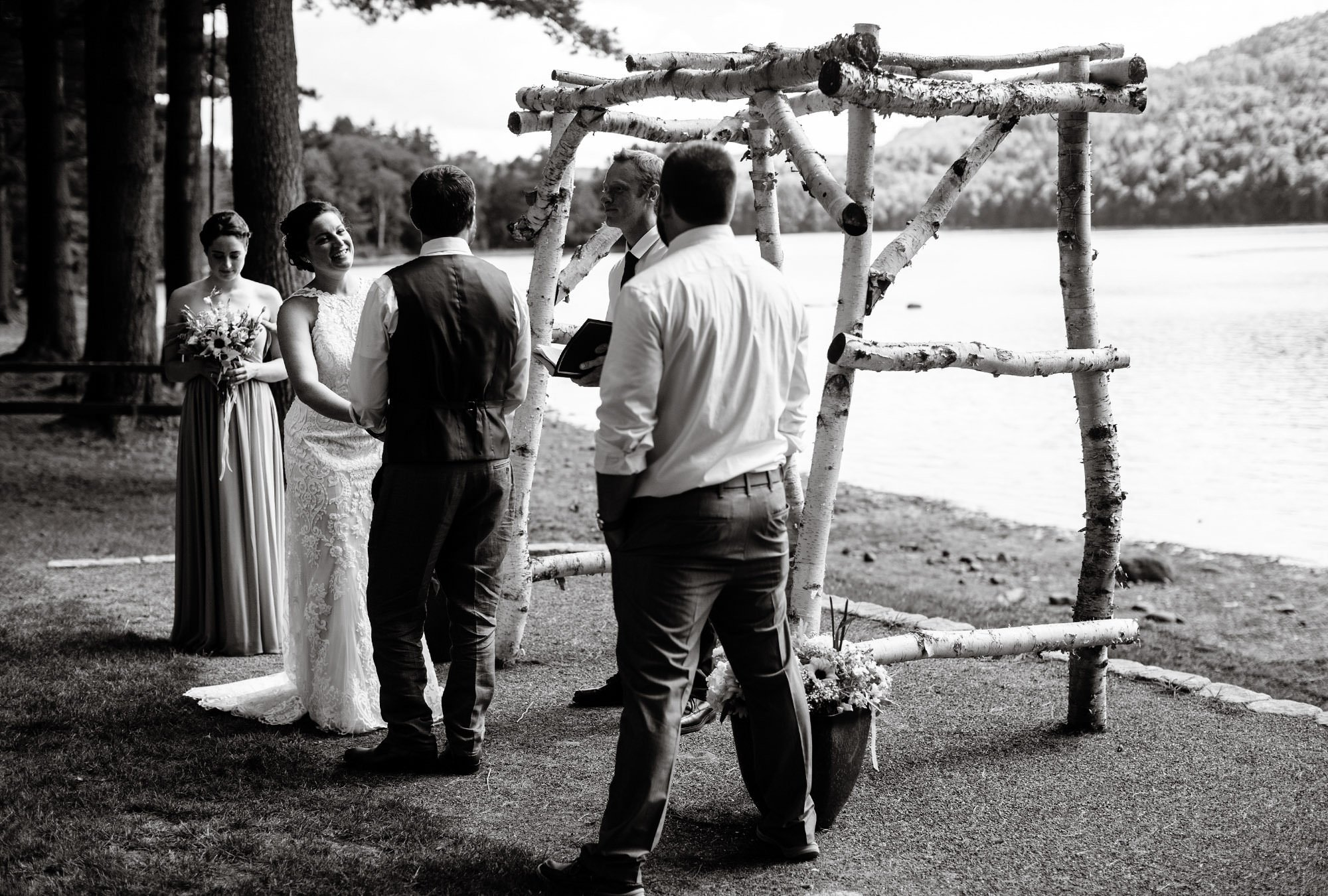 Maine Lakeside Cabin wedding  I  The wedding party participates in the ceremony along Wyman Lake.