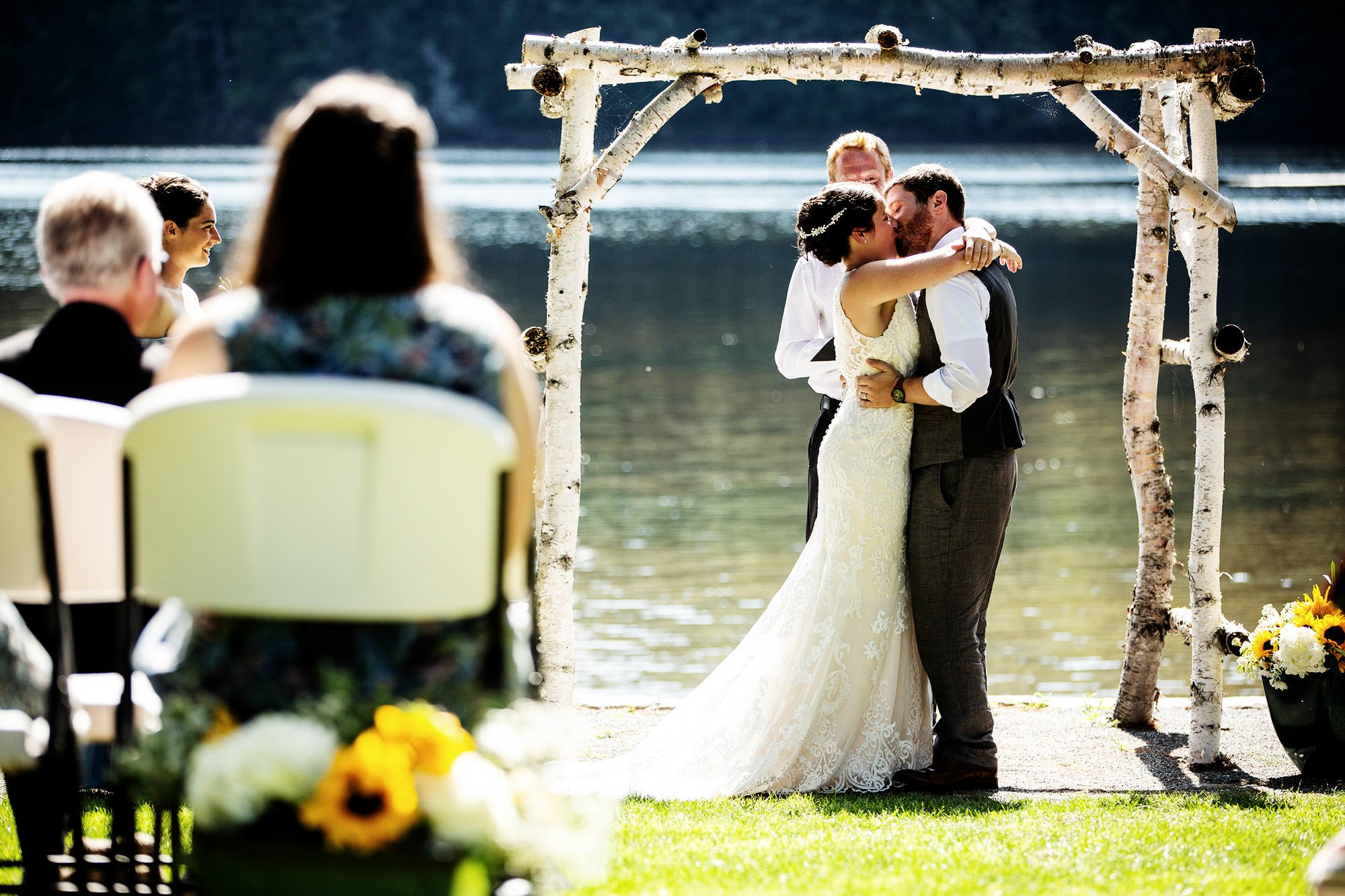 Maine Lakeside Cabin wedding  I  The couple share their first kiss.