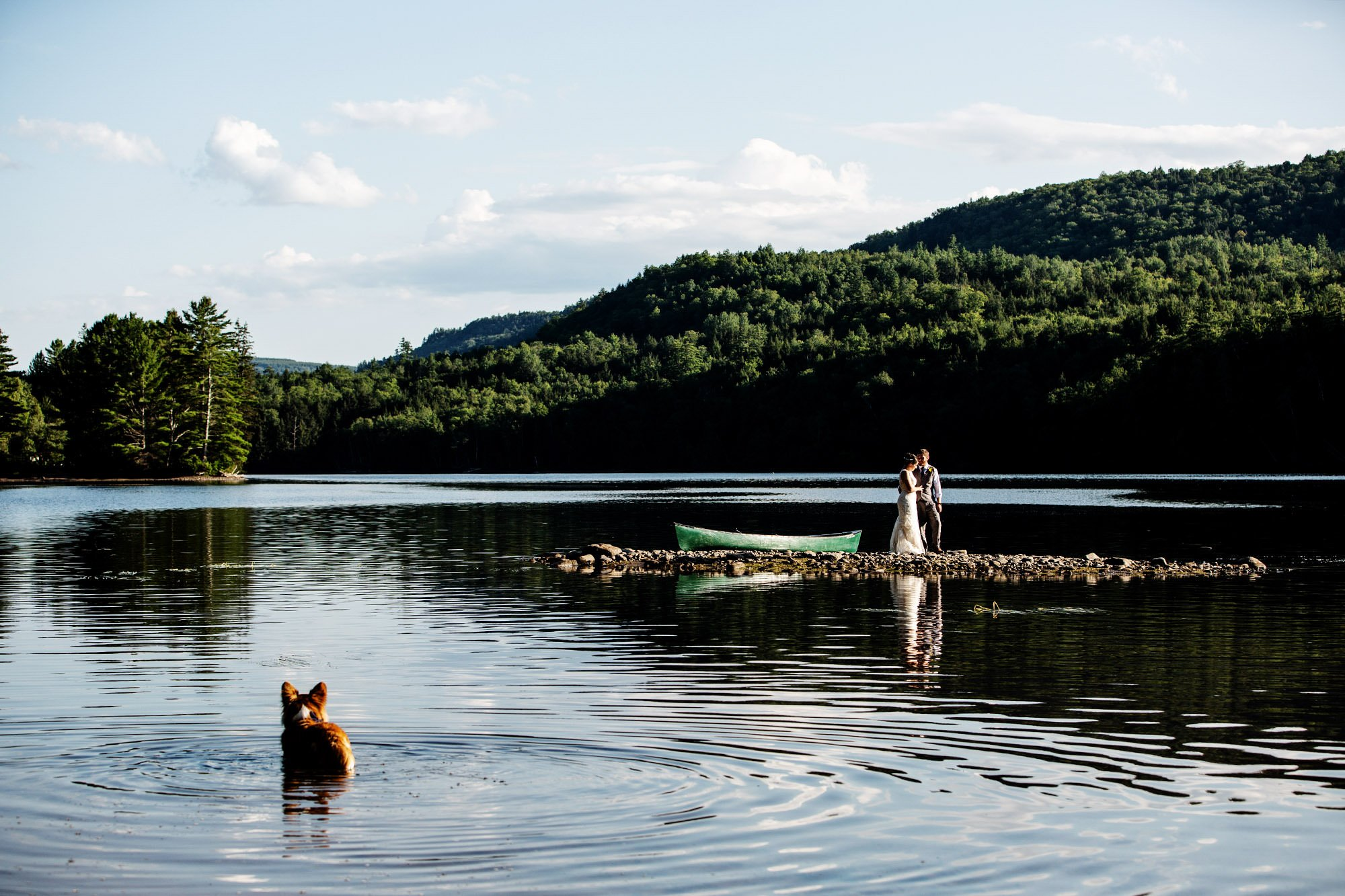 Maine Lakeside Cabin wedding  I  The couple pose for a portrait on Wyman Lake following the ceremony.