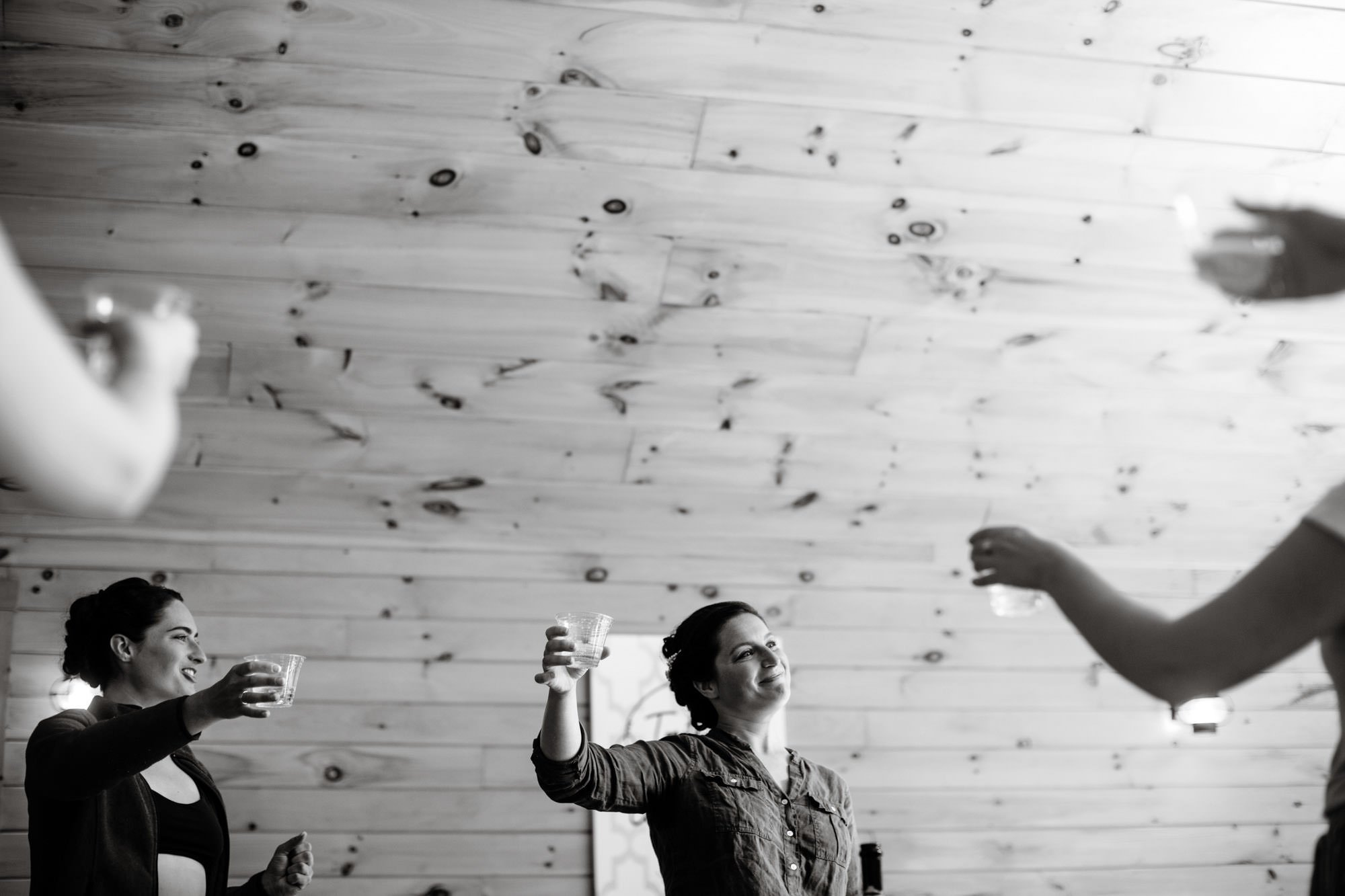 Maine Lakeside Cabin wedding  I  The bridal party gives a toast before the ceremony in Caratunk, MA.