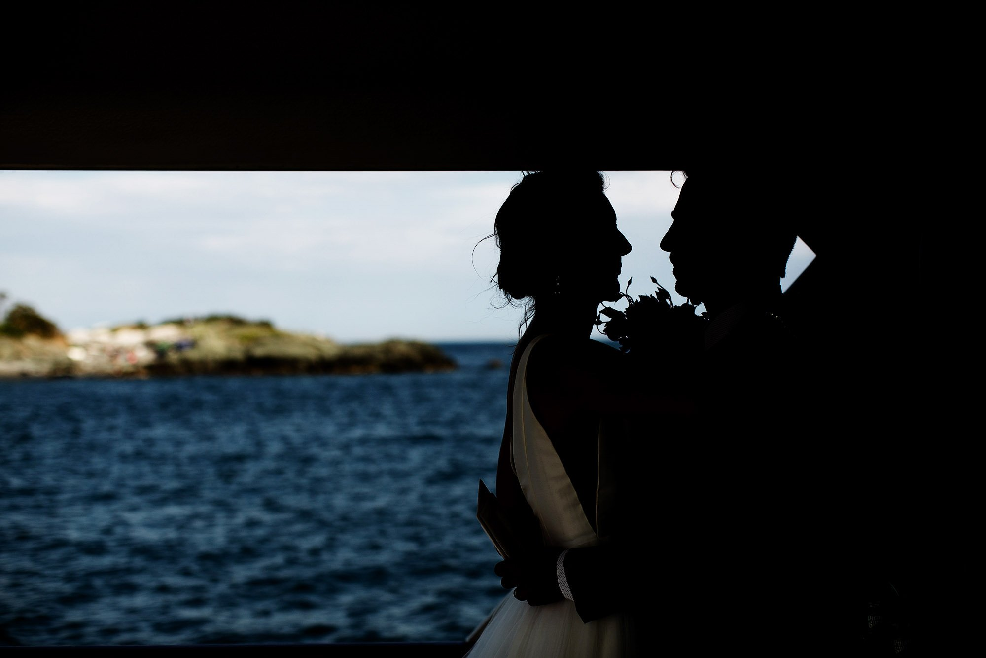Boston Harbor Wedding I The bride and groom share a quiet moment following their ceremony.
