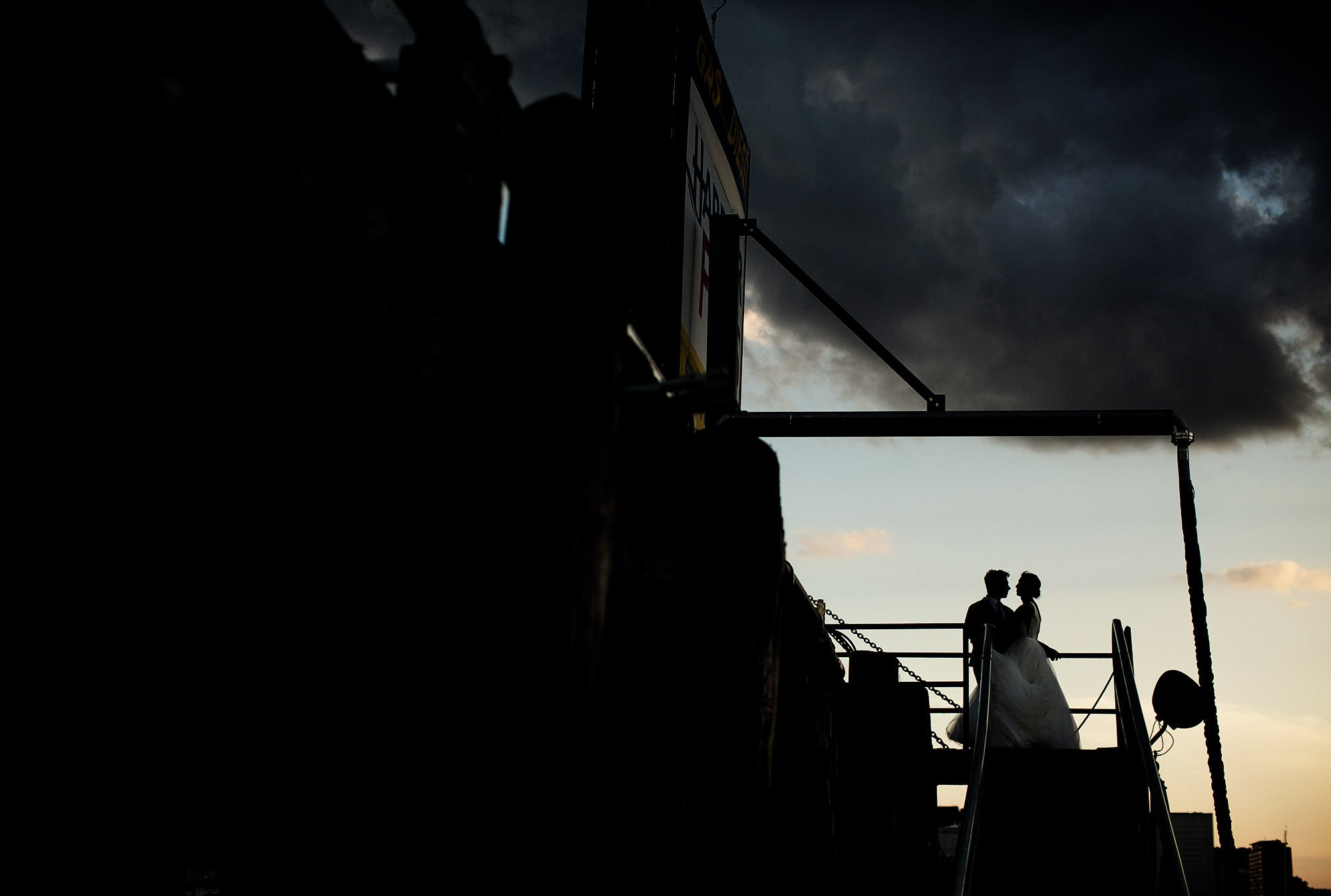 Boston Harbor Wedding I The bride and groom walk down the dock of East Boston Marina.