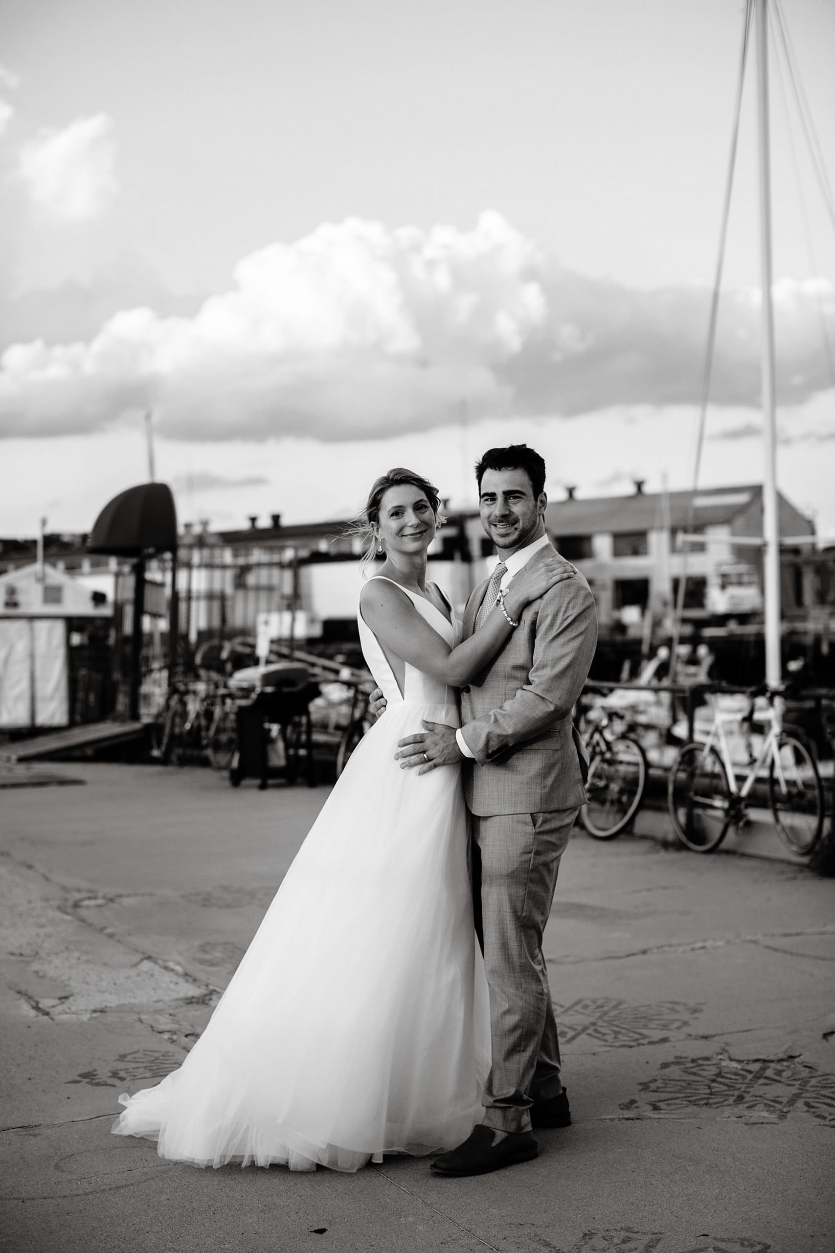Boston Harbor Wedding I The bride and groom pose at East Boston Marina.