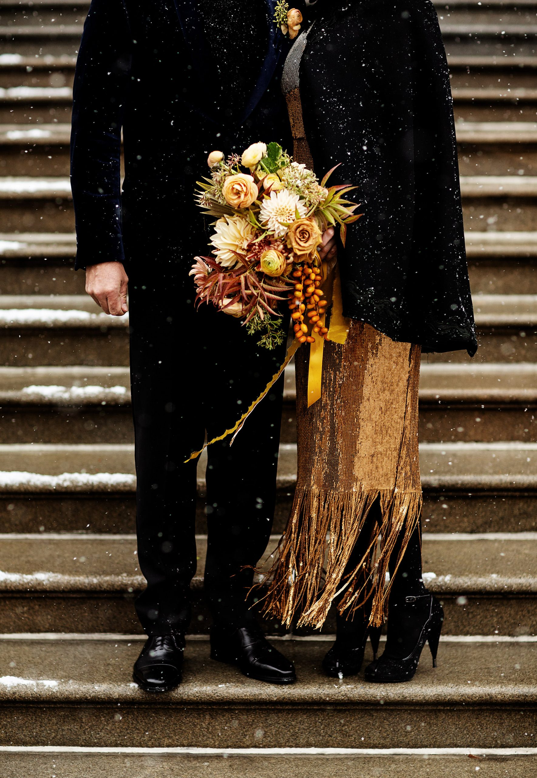 Providence City Hall Wedding  I  The couple stand on the steps of City Hall in the snow following their wedding ceremony in Providence, RI.