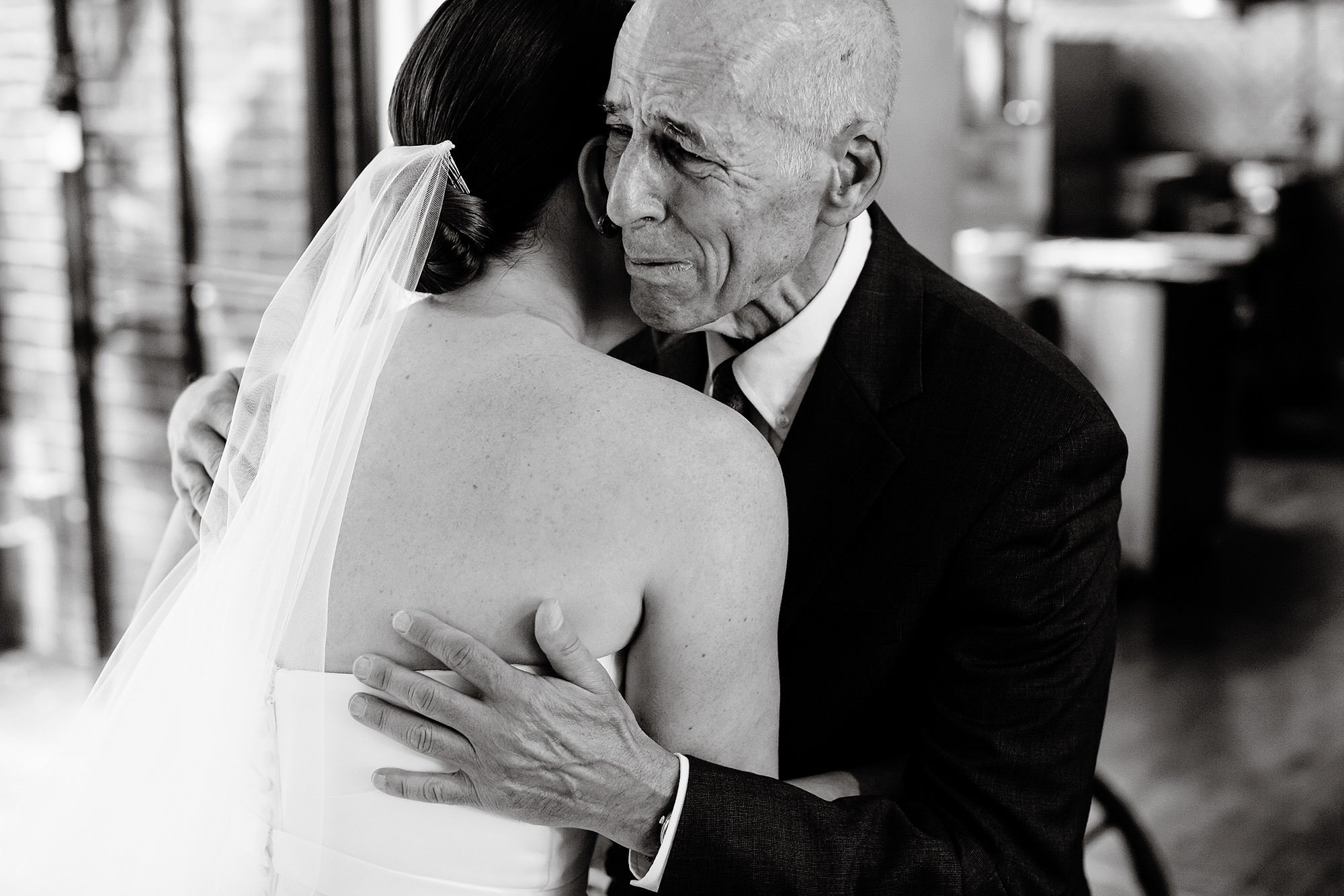 SRV Boston Wedding  I  The bride hugs her father before the wedding ceremony in Boston, MA.