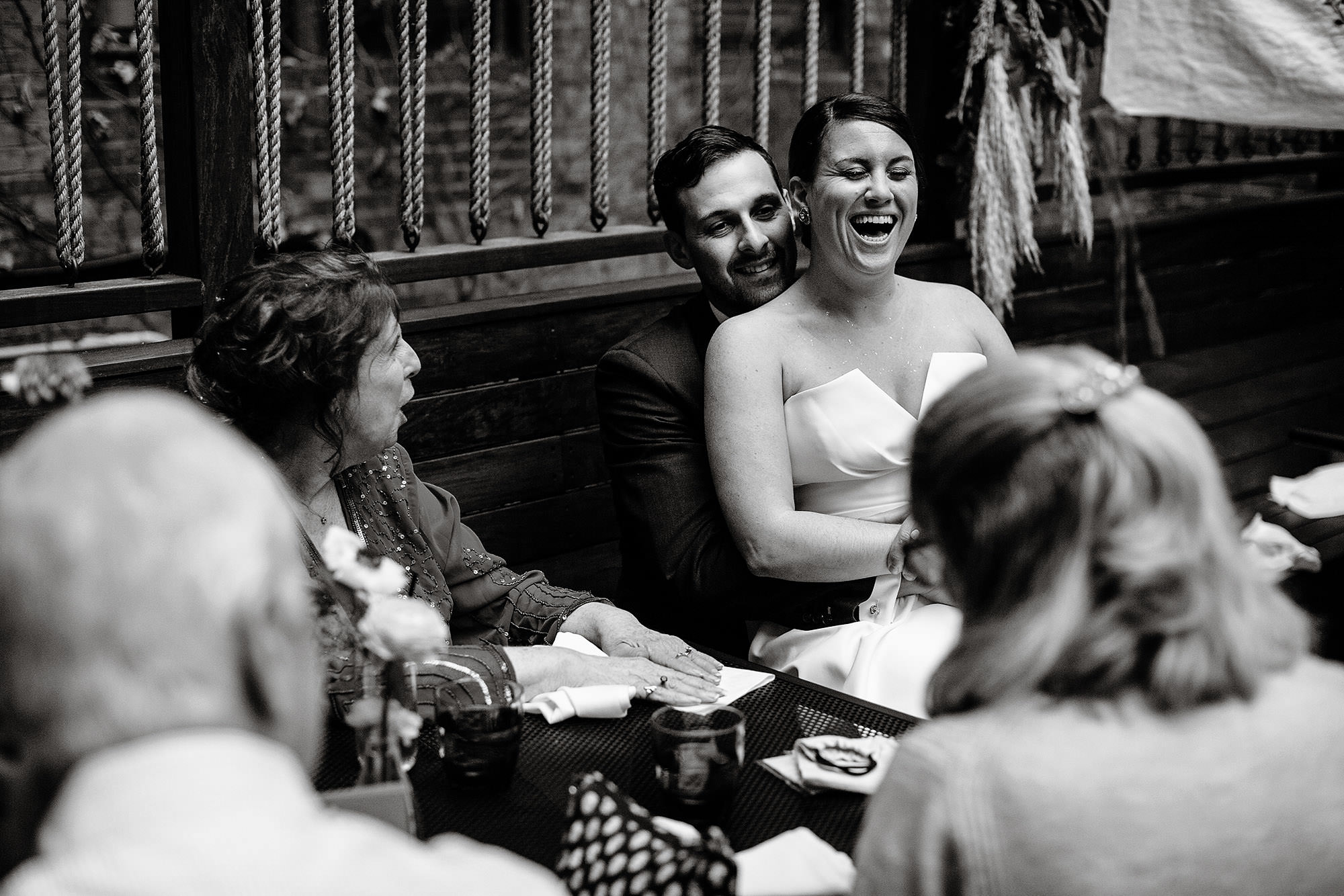 SRV Boston Wedding  I  The bride and groom laugh with guests during the cocktail hour in Boston, MA.