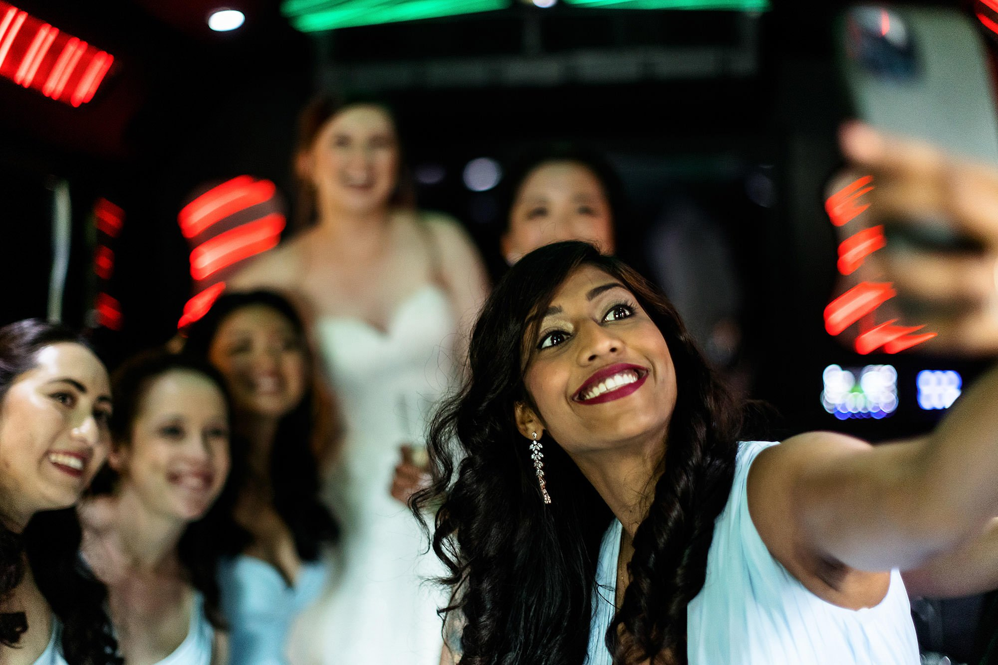 White Cliffs Country Club Wedding  I  The bridal party takes a selfie on a bus as they head to the ceremony site.