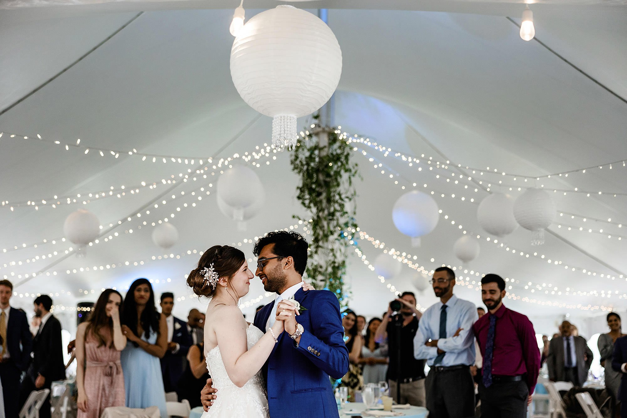 White Cliffs Country Club Wedding  I  The bride and groom share their first dance during the tented reception on Cape Cod.