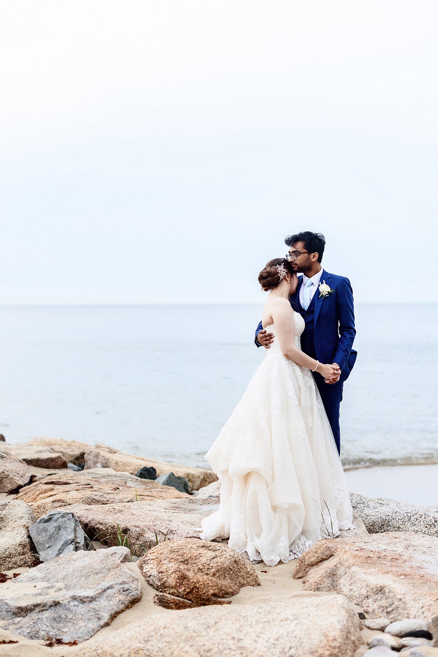 White Cliffs Country Club Wedding  I  The couple stand on a jetty following their wedding ceremony on Cape Cod.